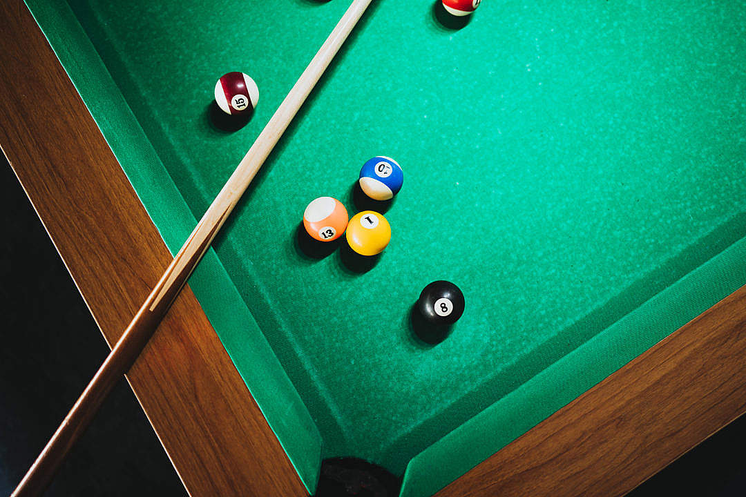 Download Cue on The Pool Table FREE Stock Photo