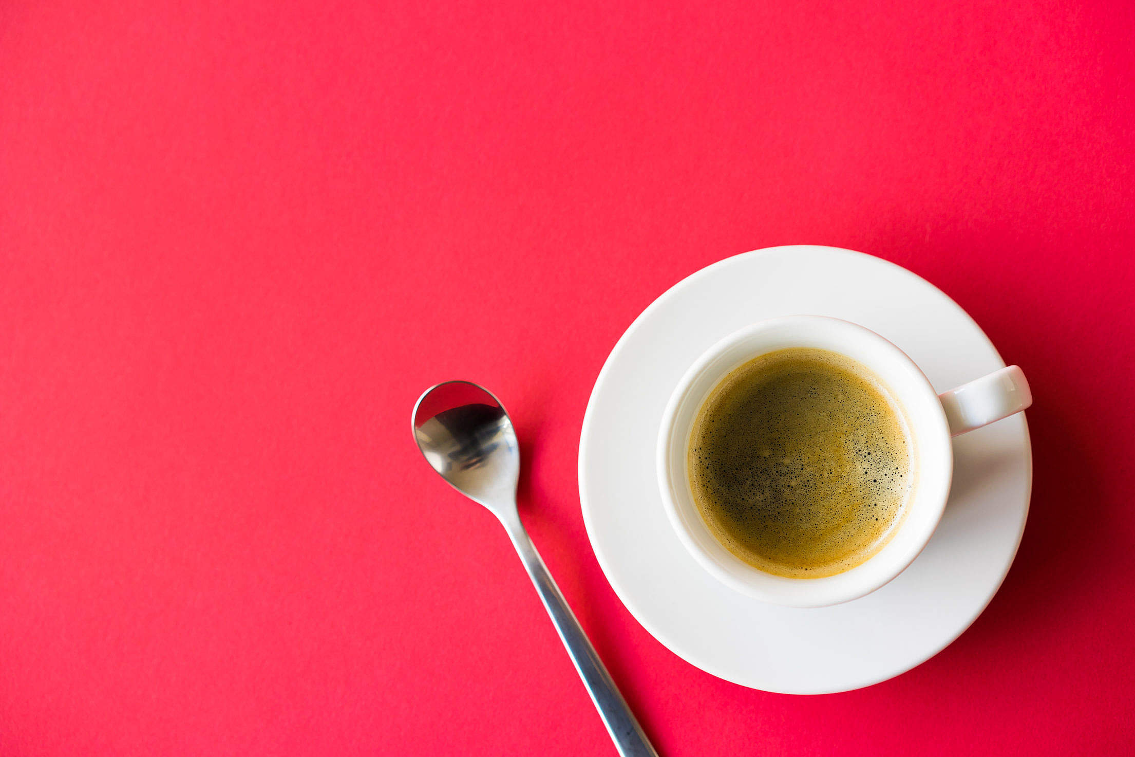 Cup of Coffee on Red Background Space for Text Free Stock Photo