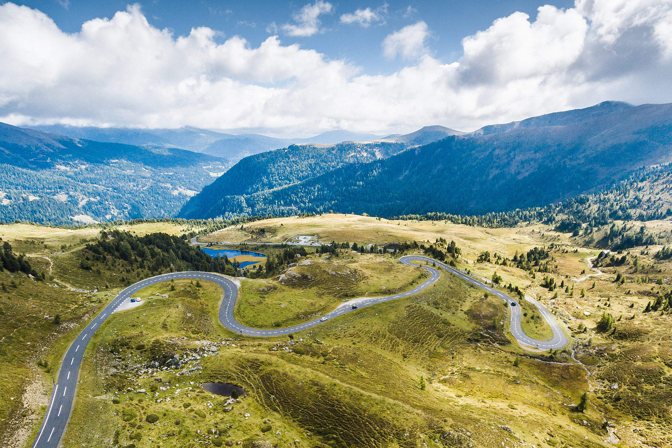 Curvy Alpine Road from Above Free Stock Photo