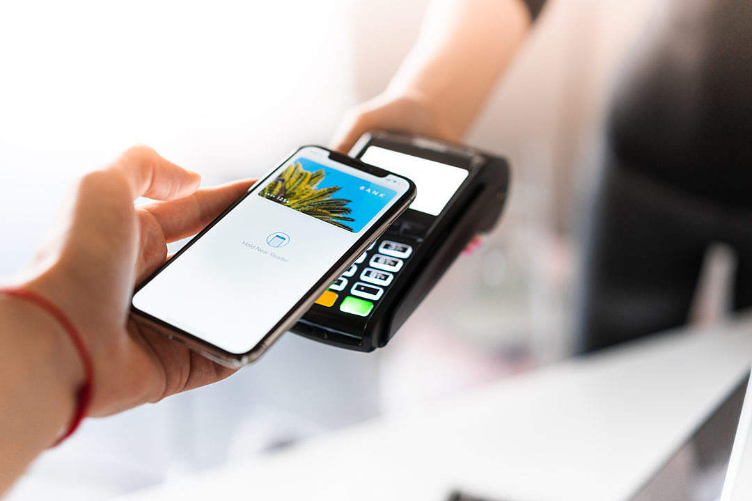 Download Customer Using Apple Pay for NFC Payment FREE Stock Photo