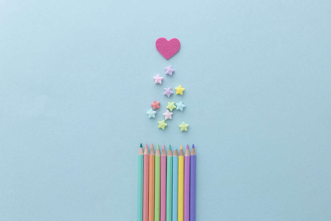 Download Cute Color Pencils on Pastel Background FREE Stock Photo