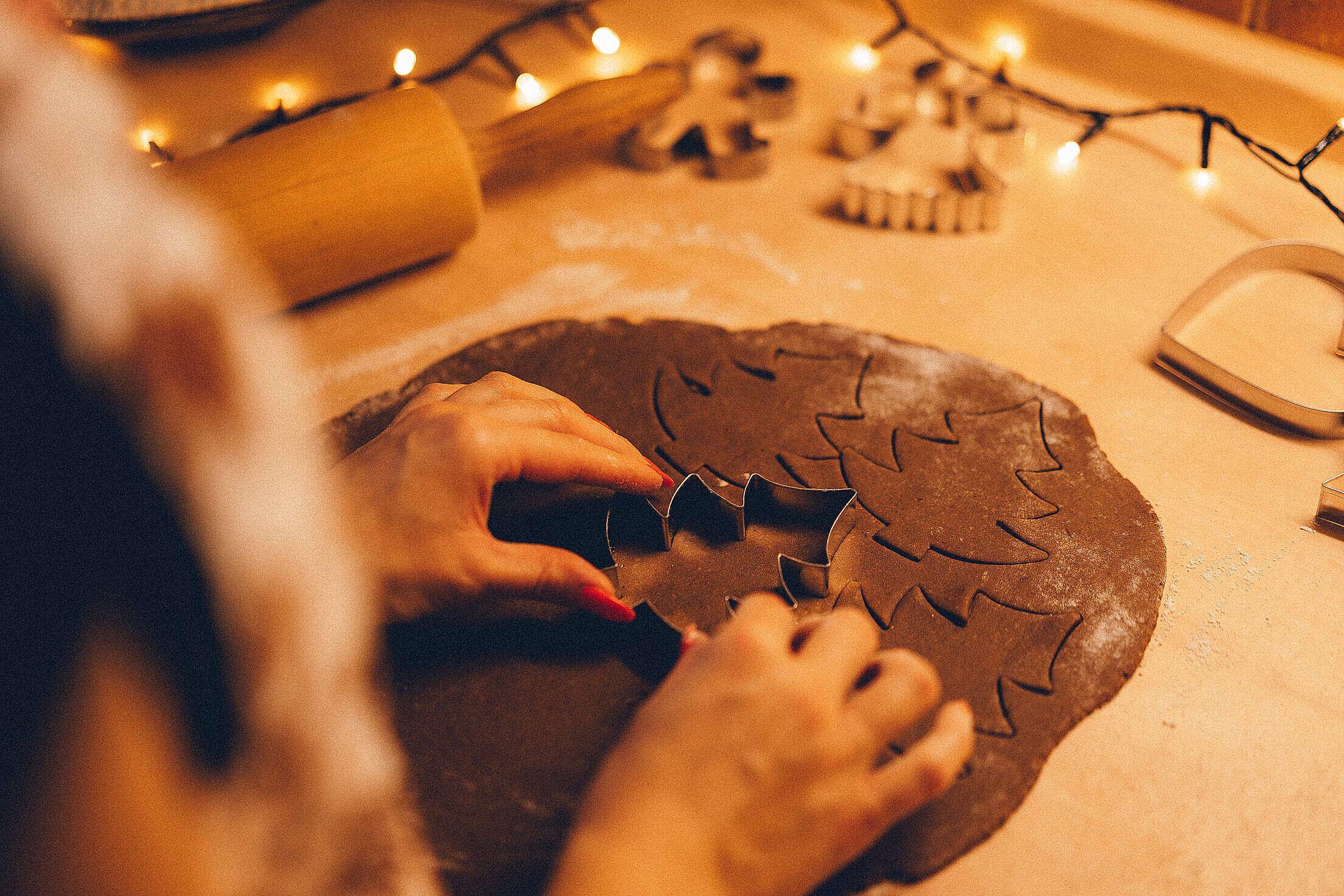 Cutting Christmas Gingerbread Dough Free Stock Photo