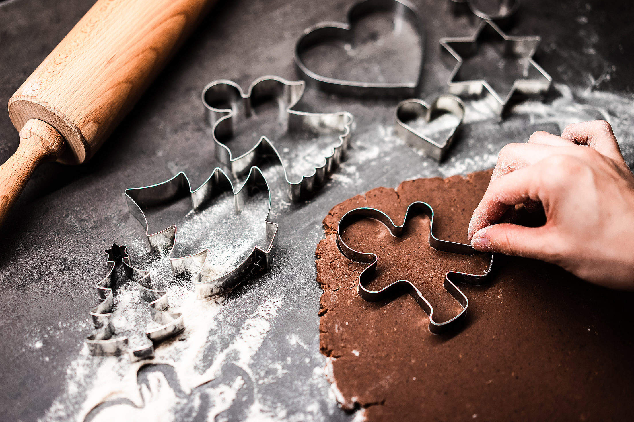Cutting Gingerbread Man at Christmas Free Stock Photo