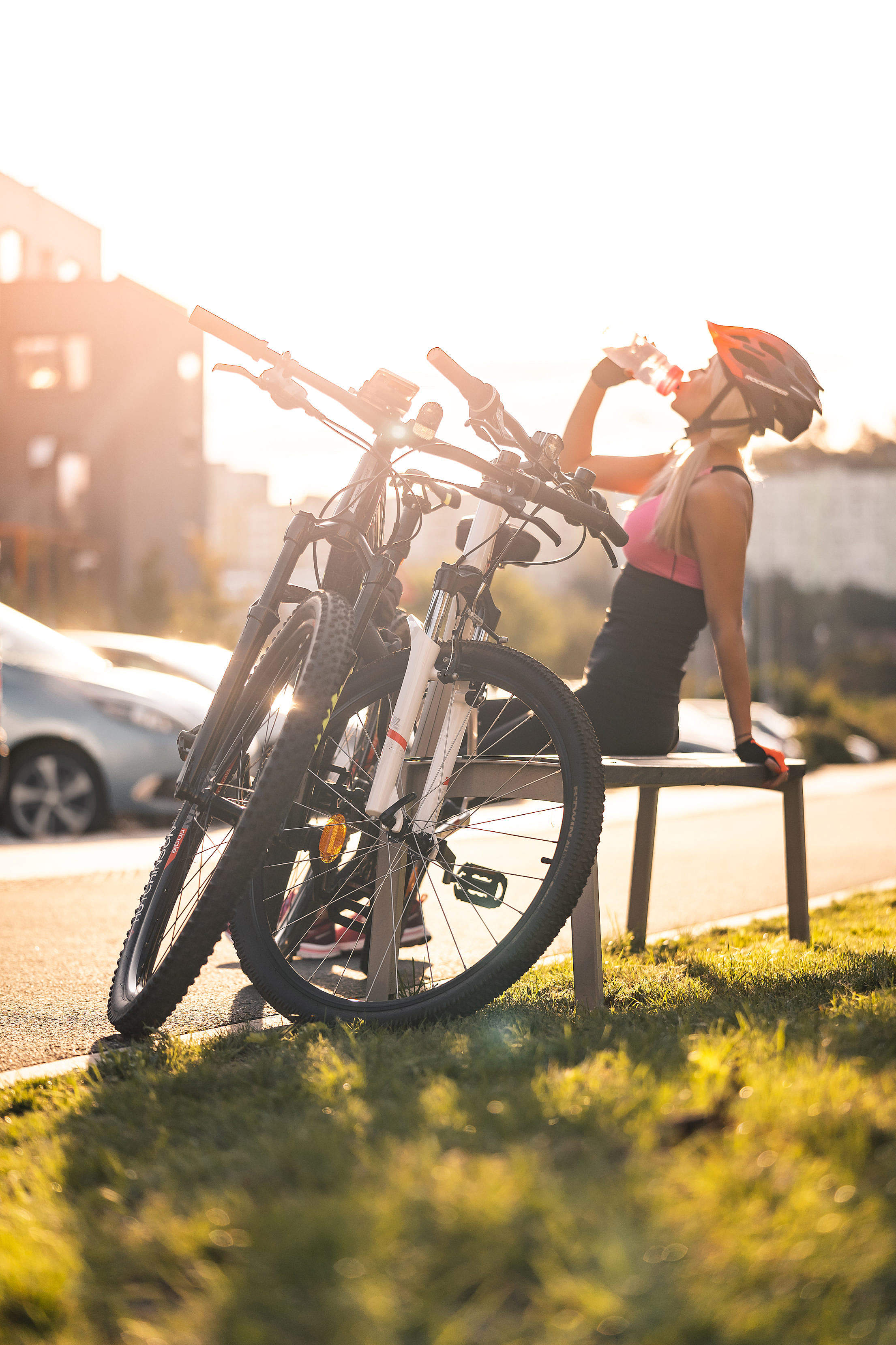 Cyclist Drinking from a Bottle Free Stock Photo