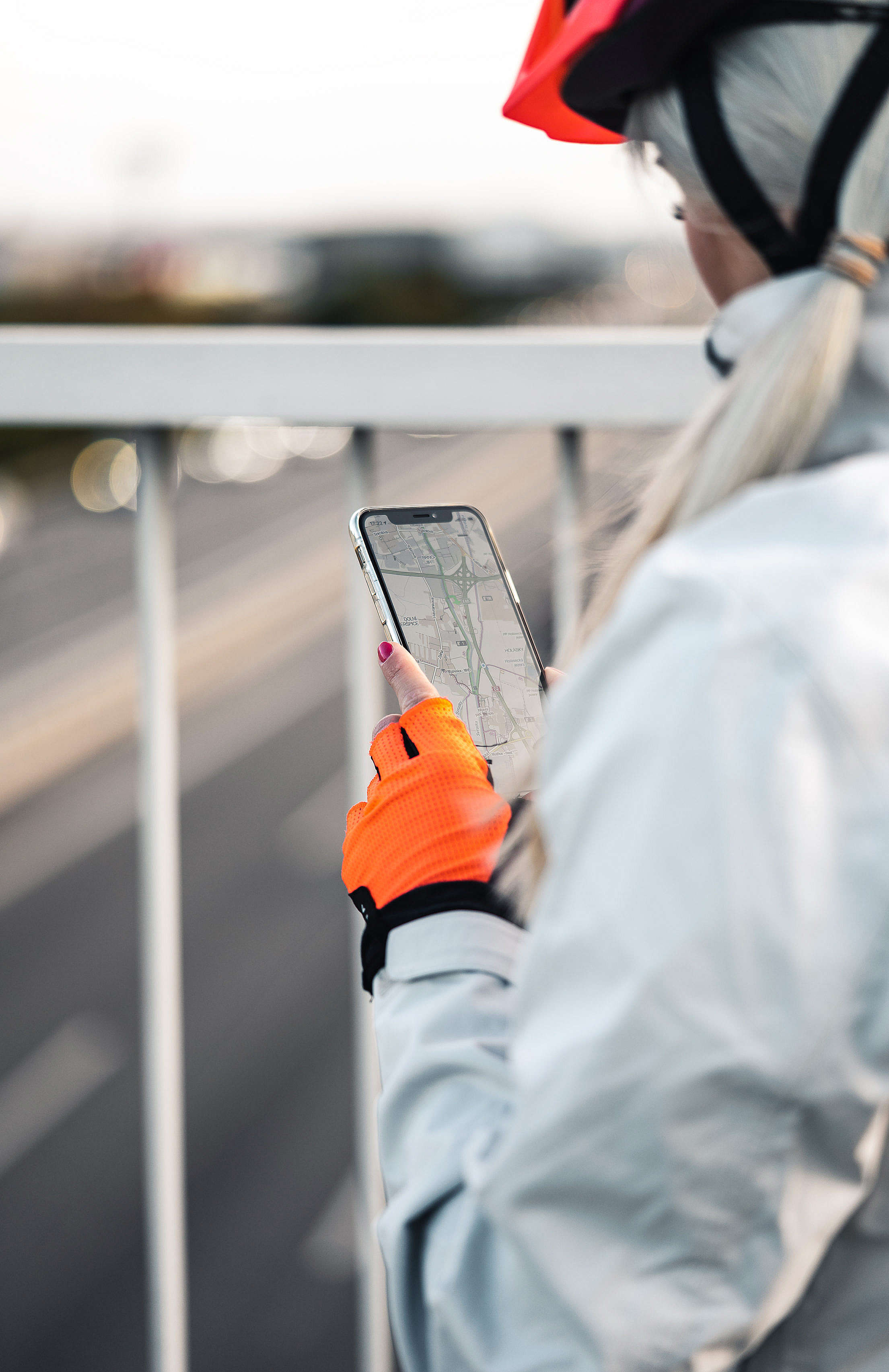 Cyclist Looking at The Map in The iPhone Free Stock Photo