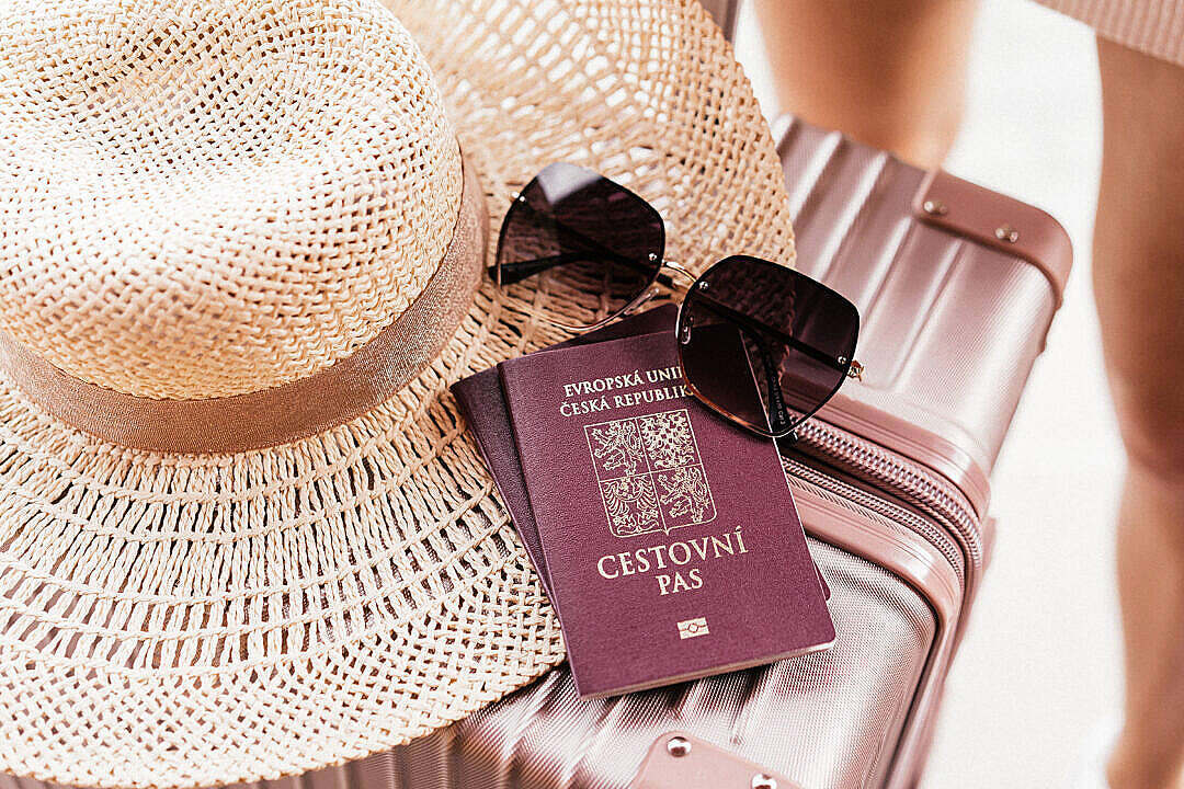 Download Czech Passport with Sunglasses and Hat on a Suitcase FREE Stock Photo