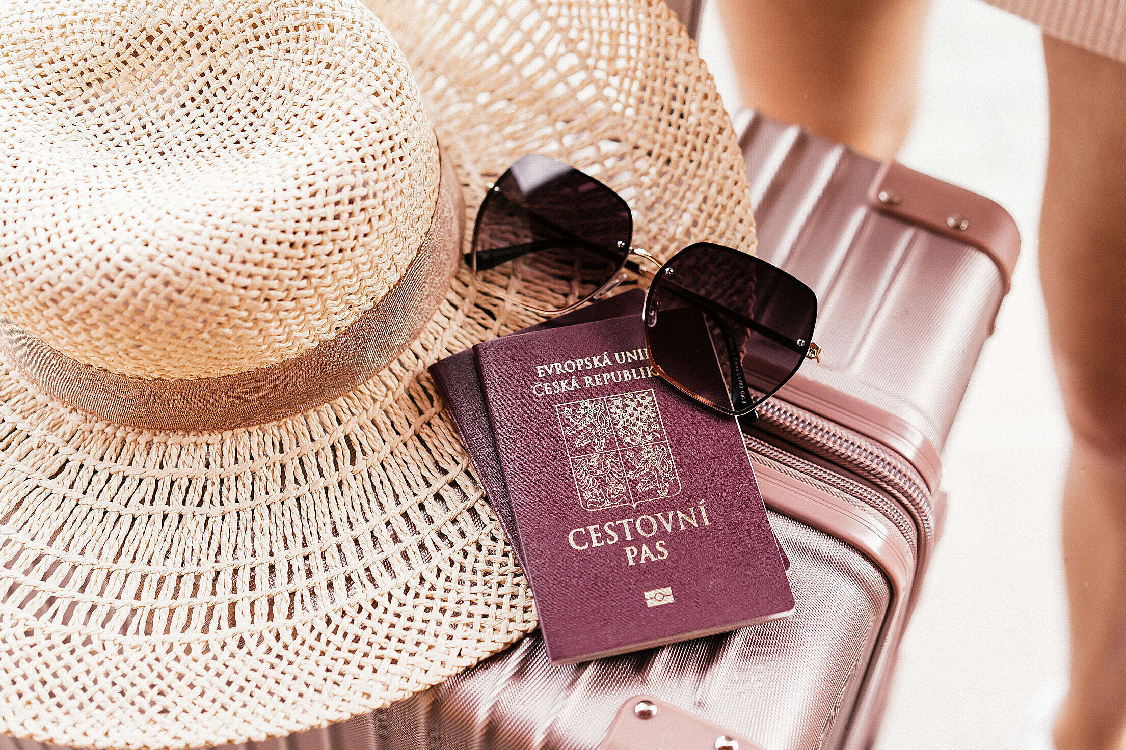Czech Passport with Sunglasses and Hat on a Suitcase Free Stock Photo