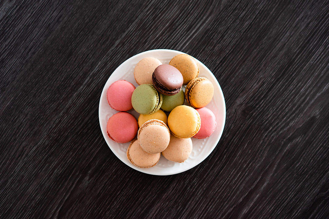 Download Delicate Homemade Macarons on The Black Wood FREE Stock Photo