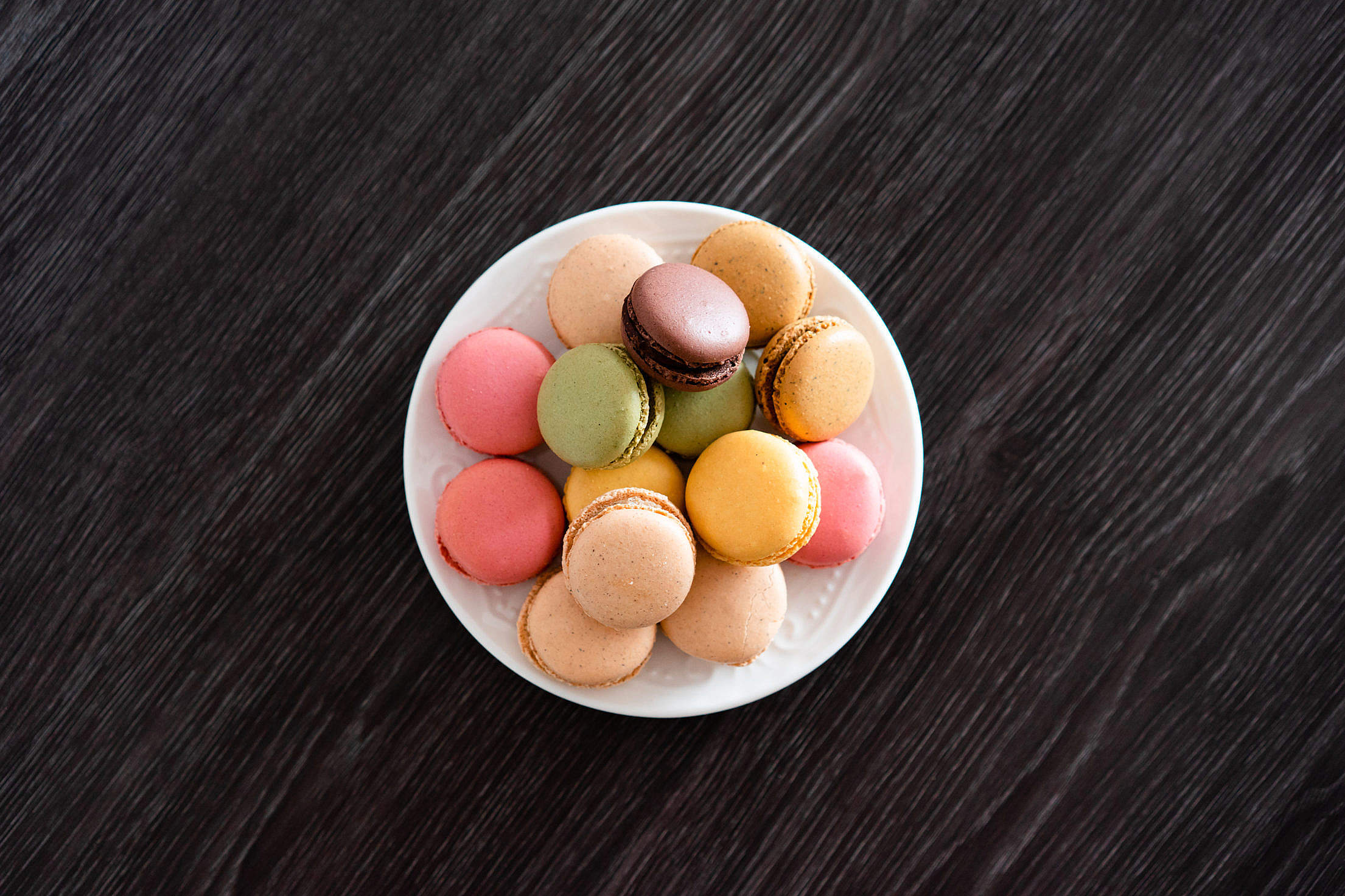 Delicate Homemade Macarons on The Black Wood Free Stock Photo