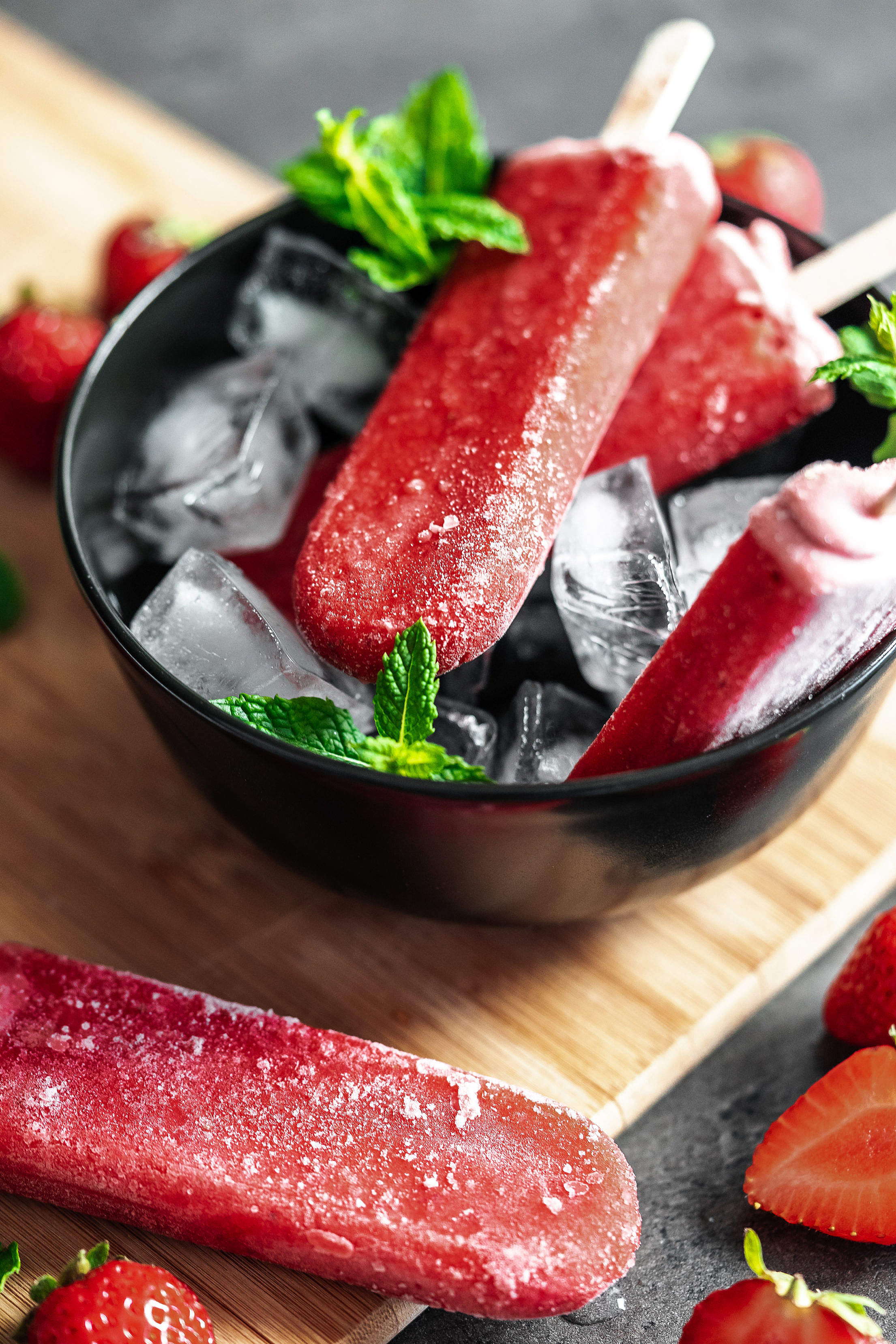 Delicious Strawberry Popsicles on a Wooden Board Free Stock Photo