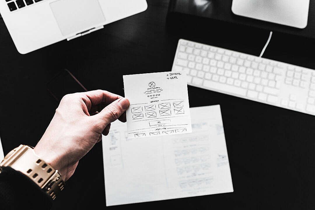 Download Designer Showing Web Design Layout Sketches FREE Stock Photo
