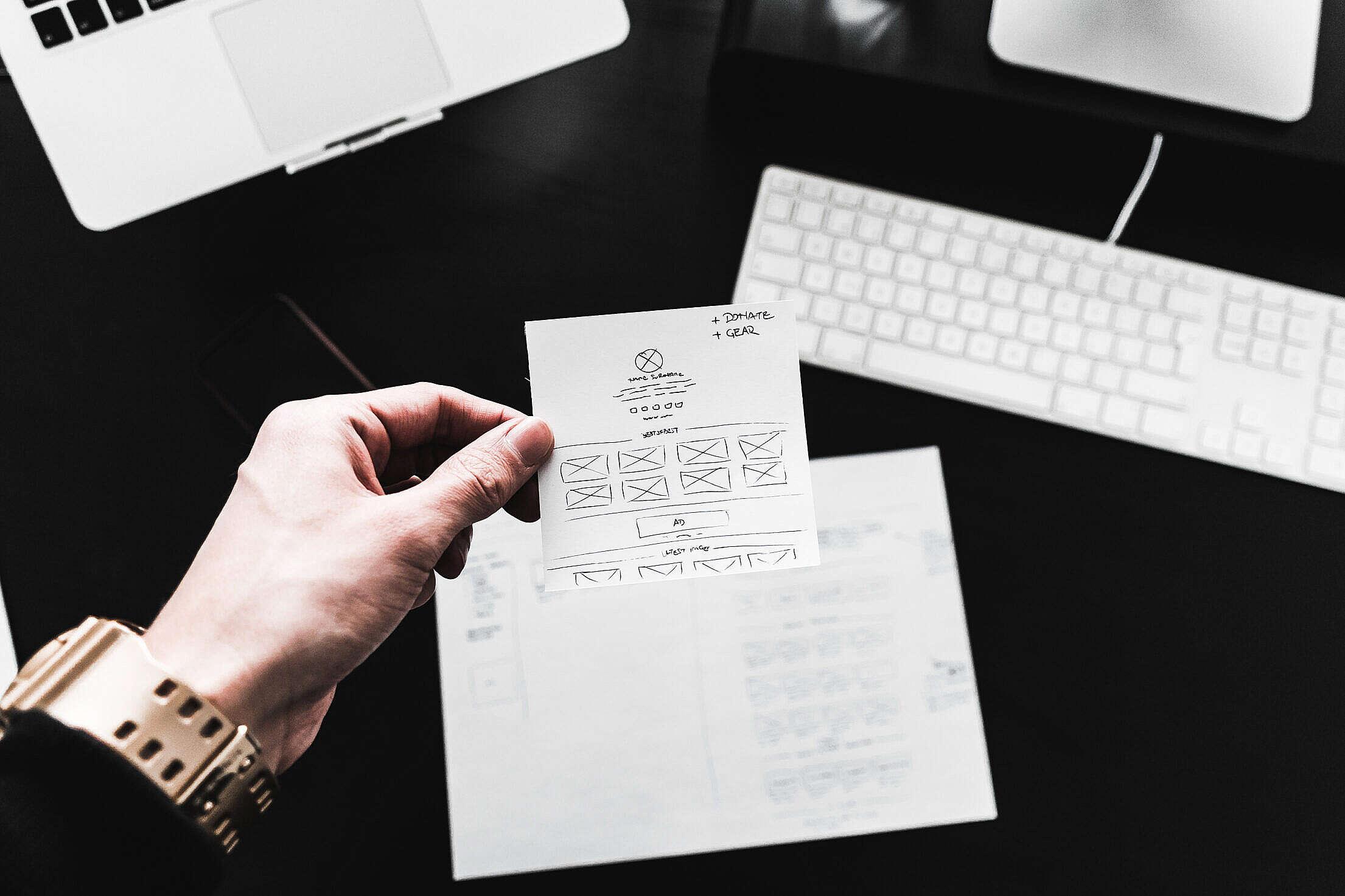 Designer Showing Web Design Layout Sketches Free Stock Photo