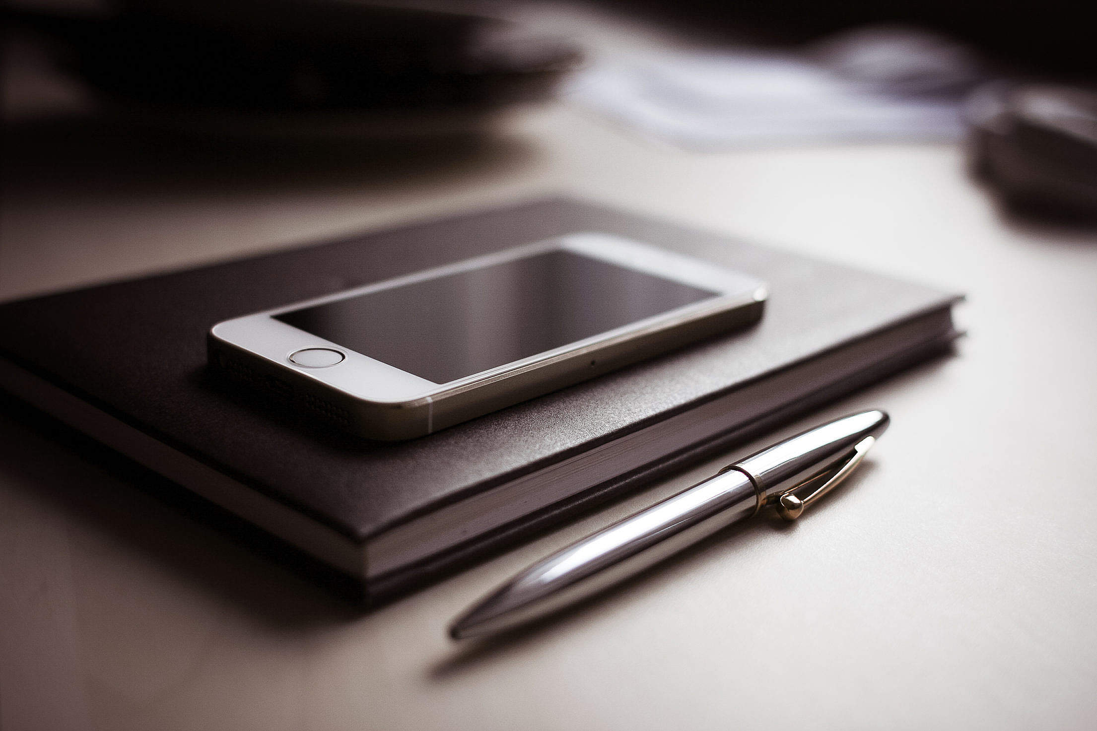 Diary with new iPhone 5S and Pen Free Stock Photo