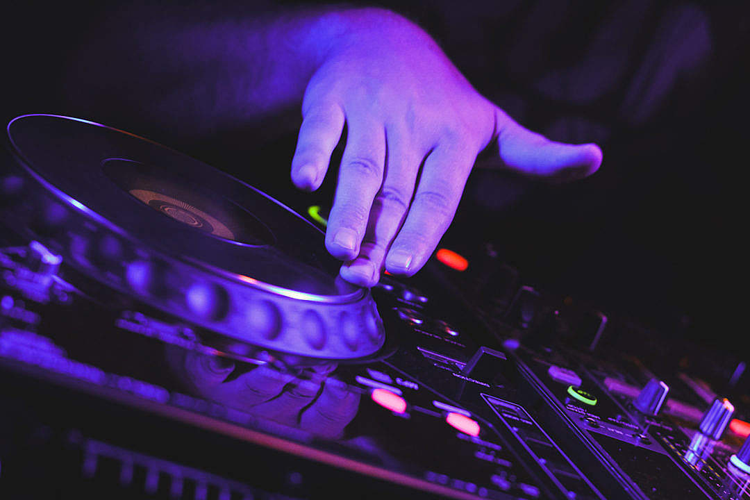 Download DJ's Scratching on CD Players Hand Close Up FREE Stock Photo