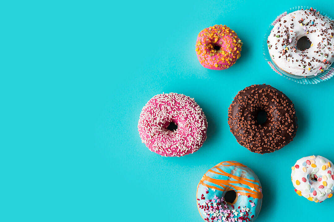 Download Donuts on Blue Background FREE Stock Photo