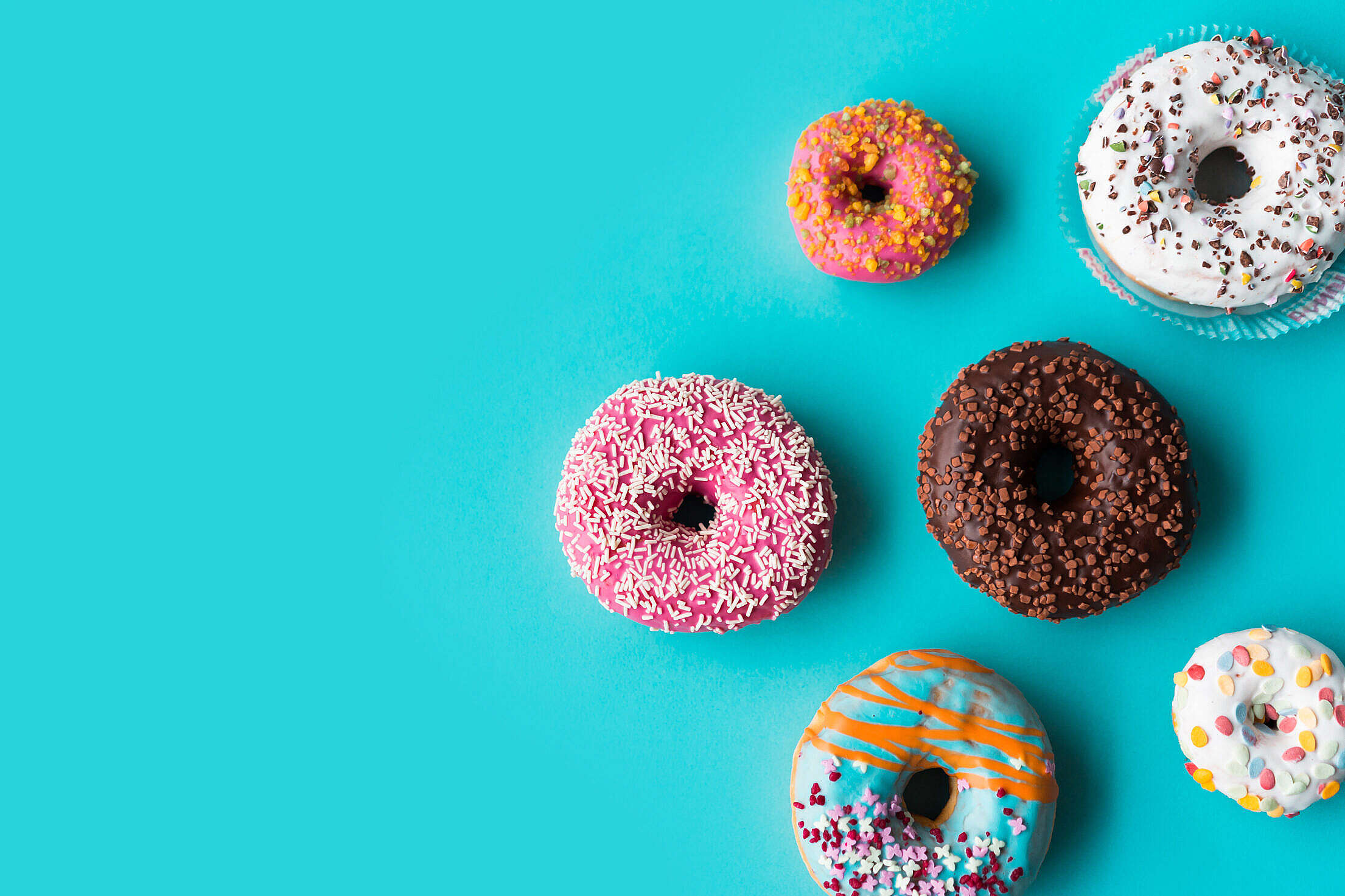 Donuts on Blue Background Free Stock Photo