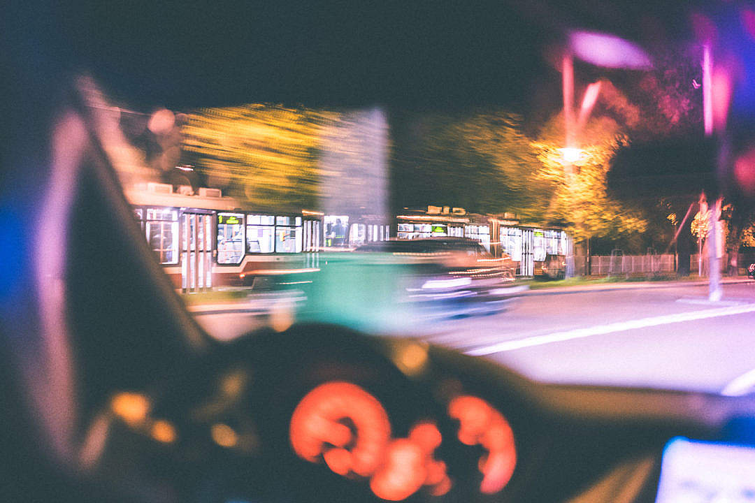 Download Driver Racing Against City Tram at Night FREE Stock Photo