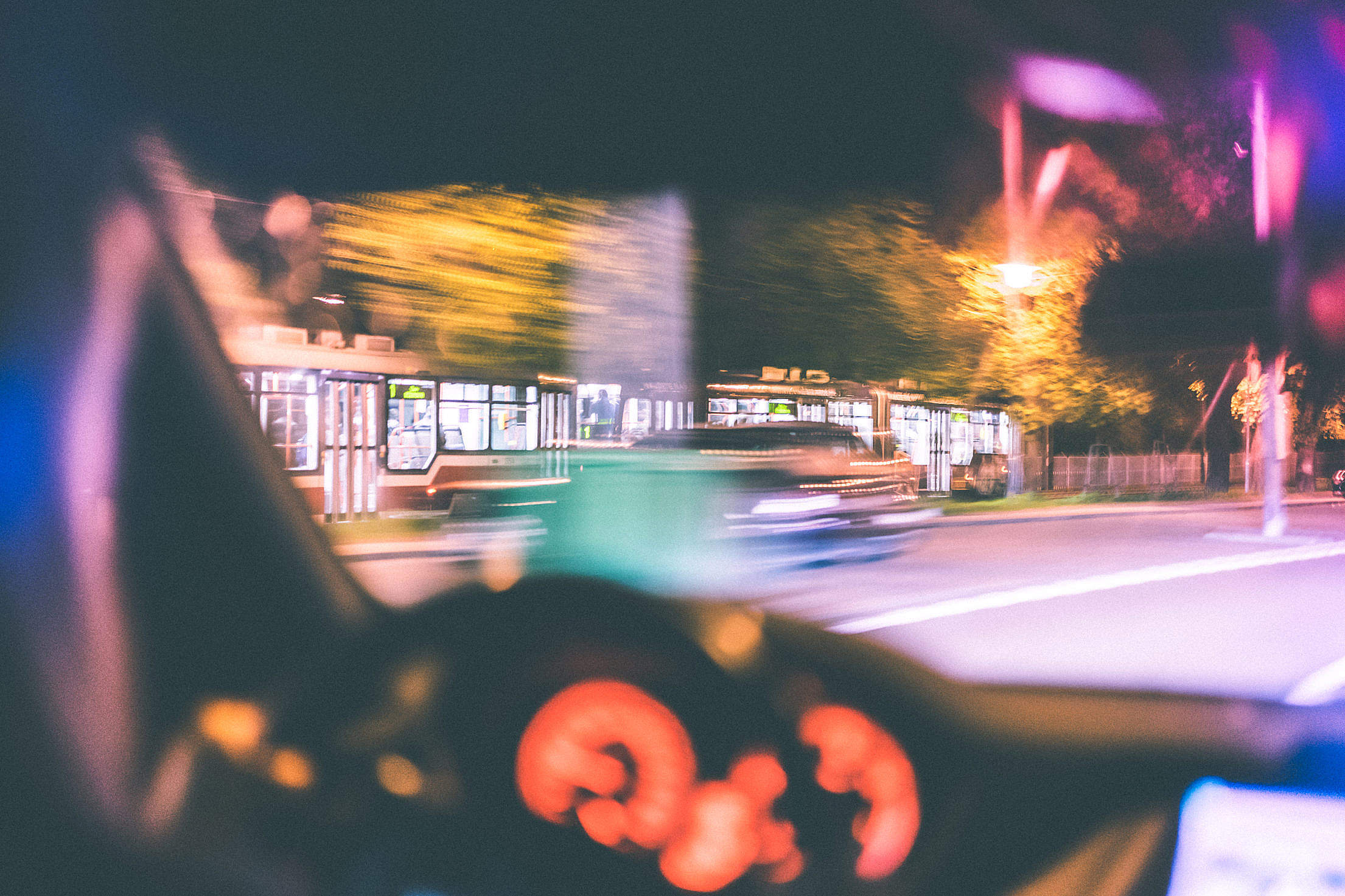 Driver Racing Against City Tram at Night Free Stock Photo