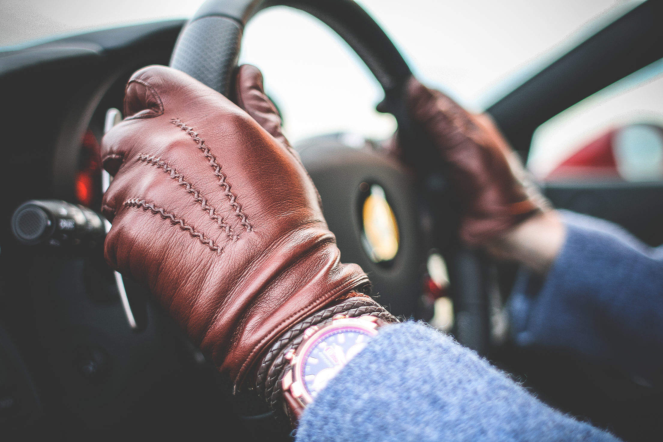 Driver with Brown Leather Driving Gloves Free Stock Photo