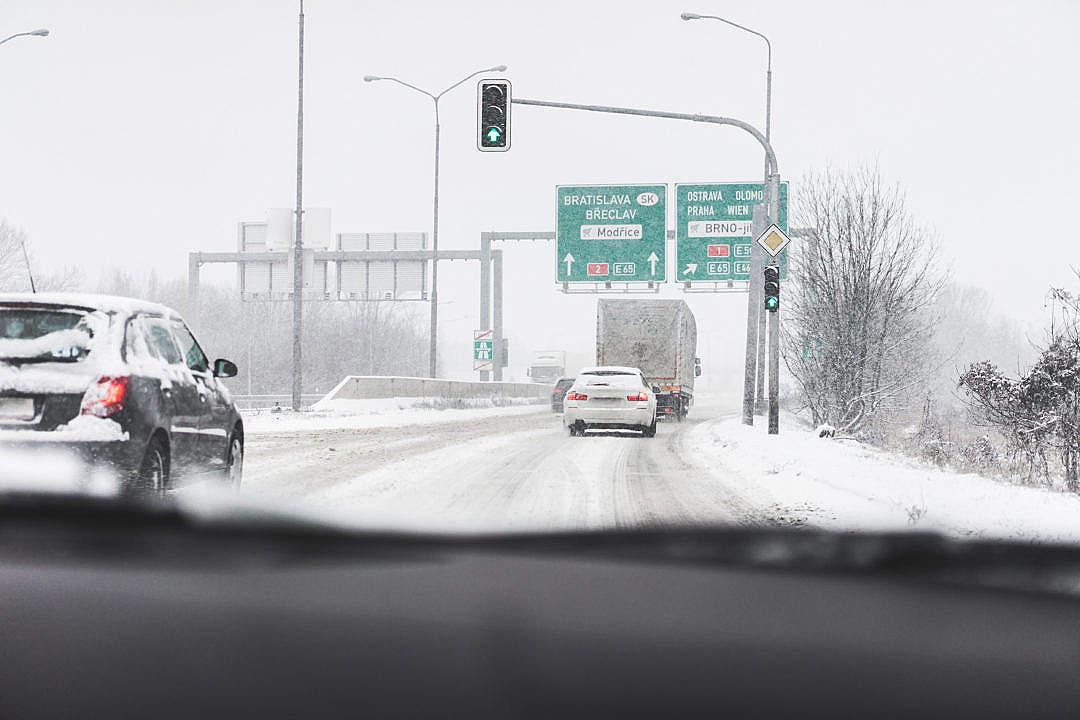 Download Driving in a Dangerous Snowy Weather on a Highway FREE Stock Photo