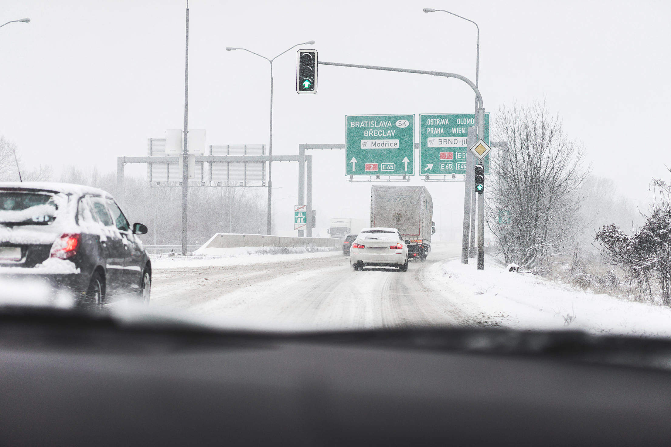 Driving in a Dangerous Snowy Weather on a Highway Free Stock Photo