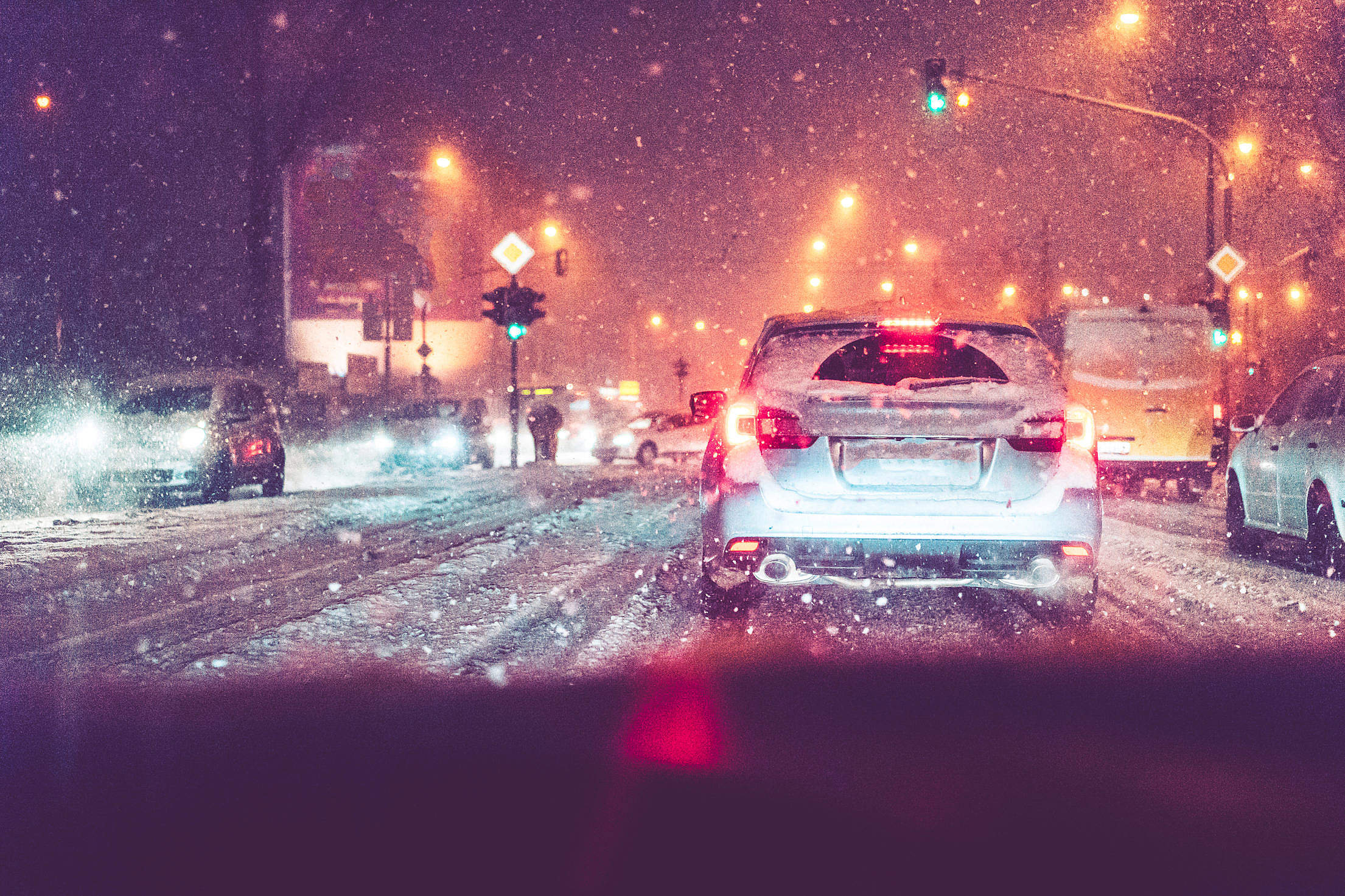 Driving in Evening Traffic Jam and Snow Calamity Weather Free Stock Photo