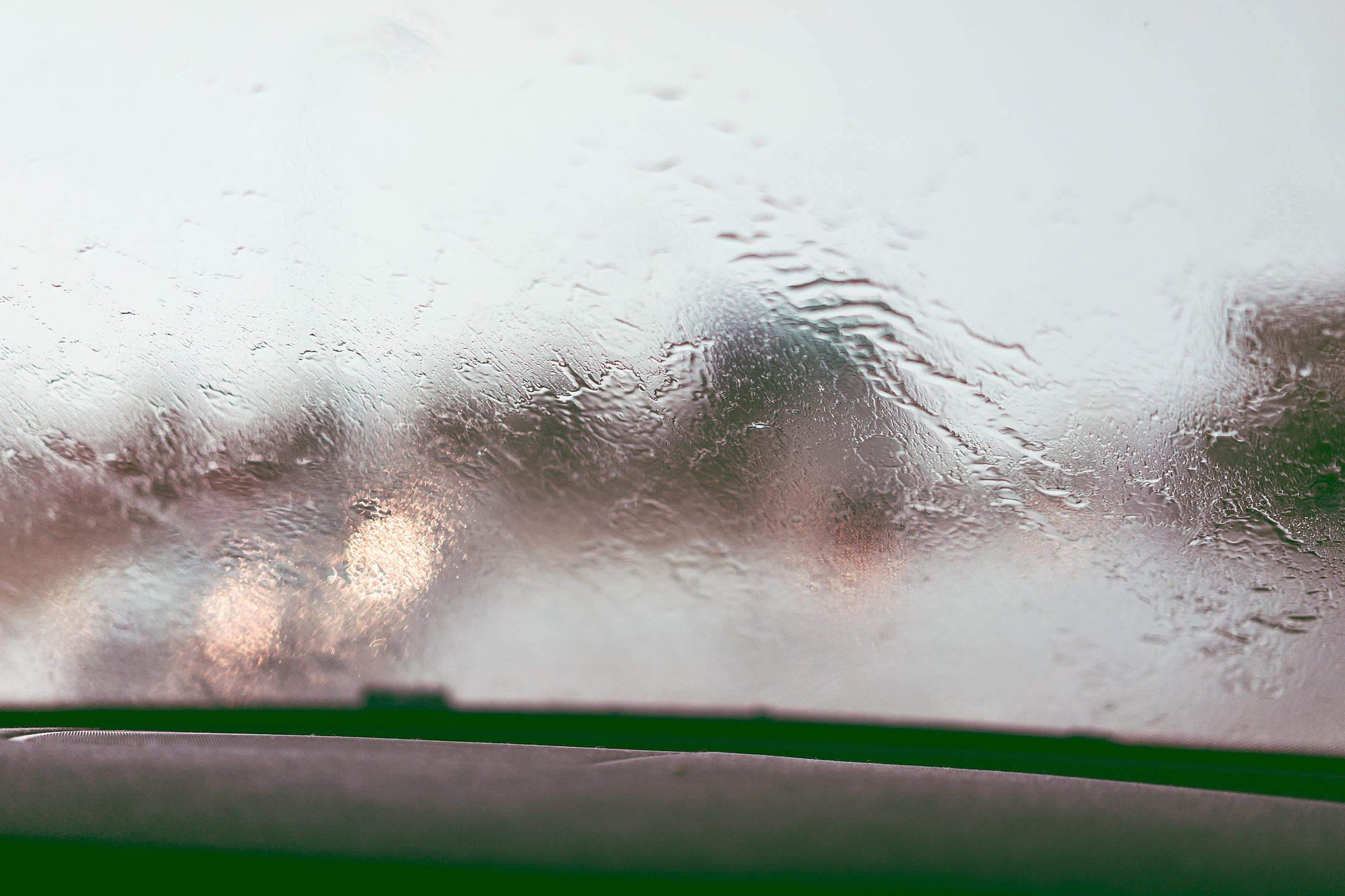 Driving in The Rain Water on Windshield Free Stock Photo