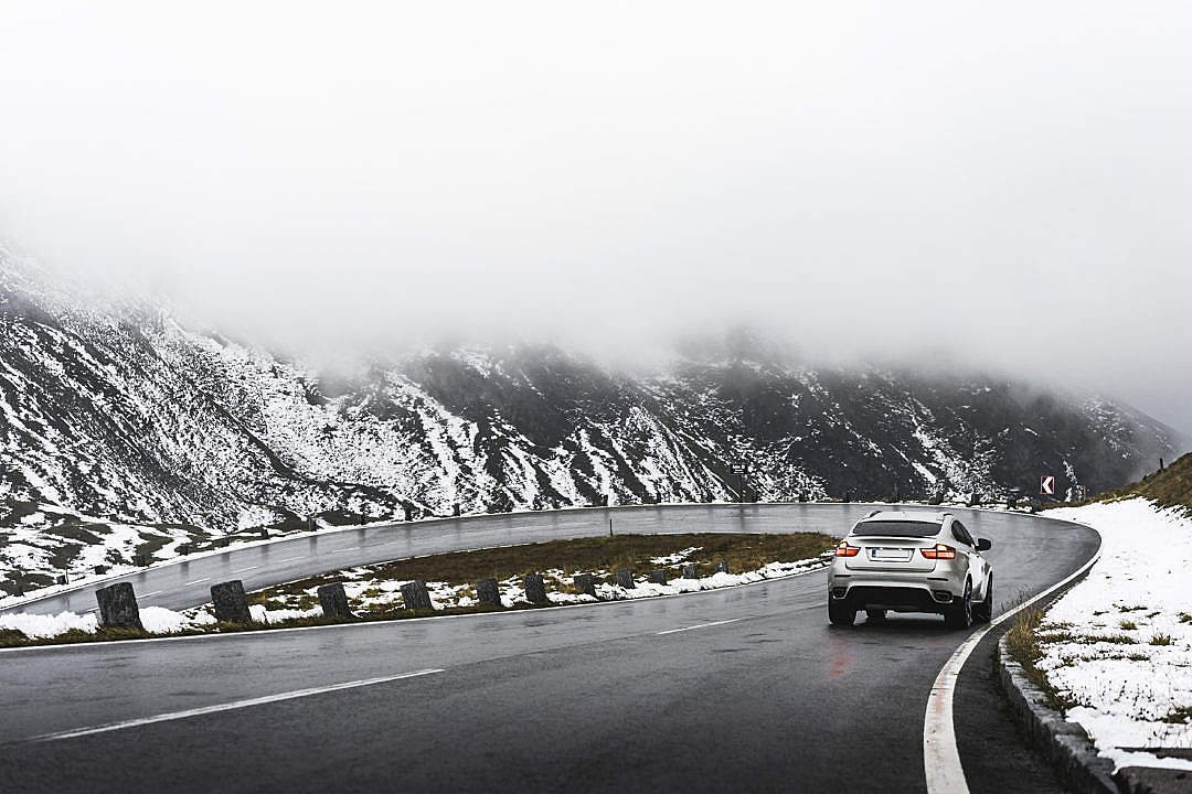 Download Driving on Grossglockner Mountain Road in Winter Weather FREE Stock Photo