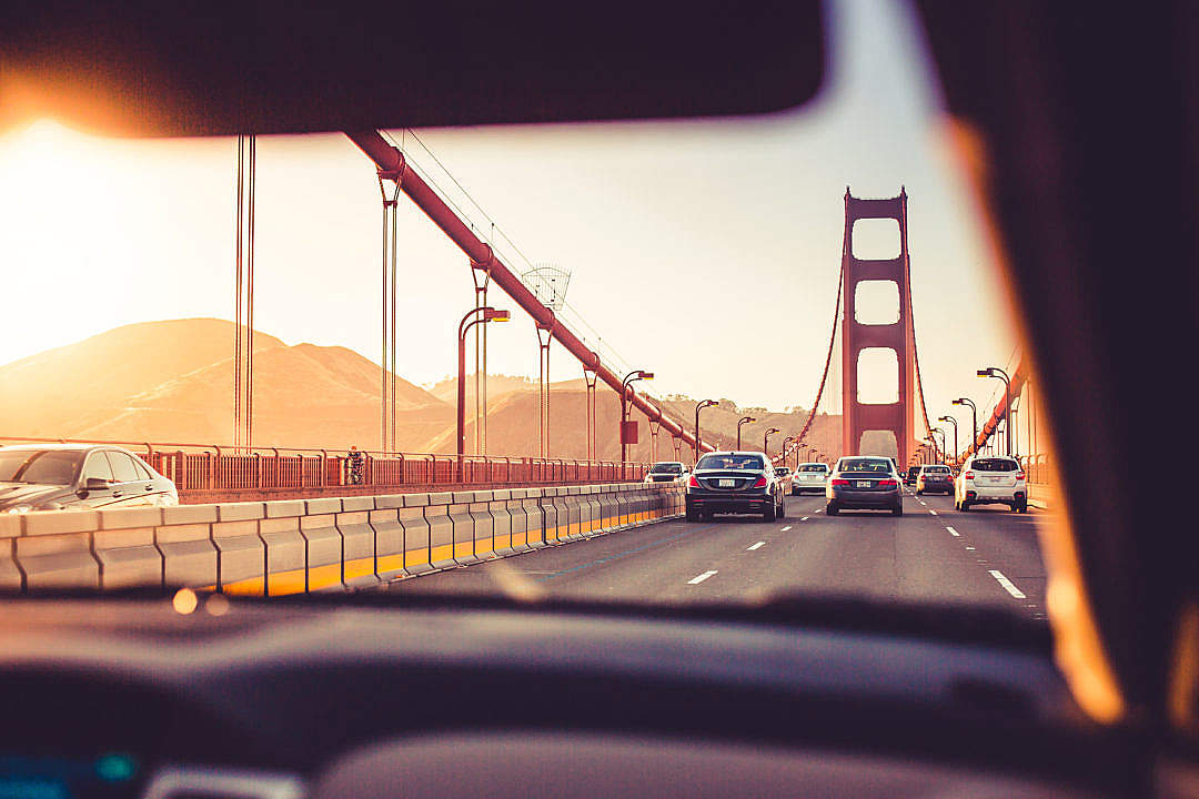 Download Driving Over The Golden Gate Bridge in Sunset FREE Stock Photo