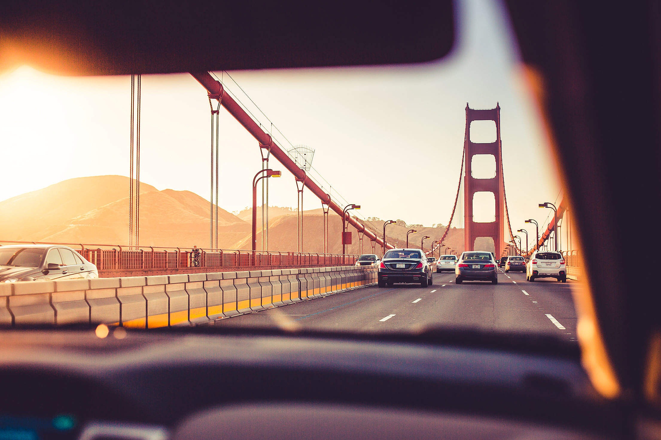 Driving Over The Golden Gate Bridge in Sunset Free Stock Photo