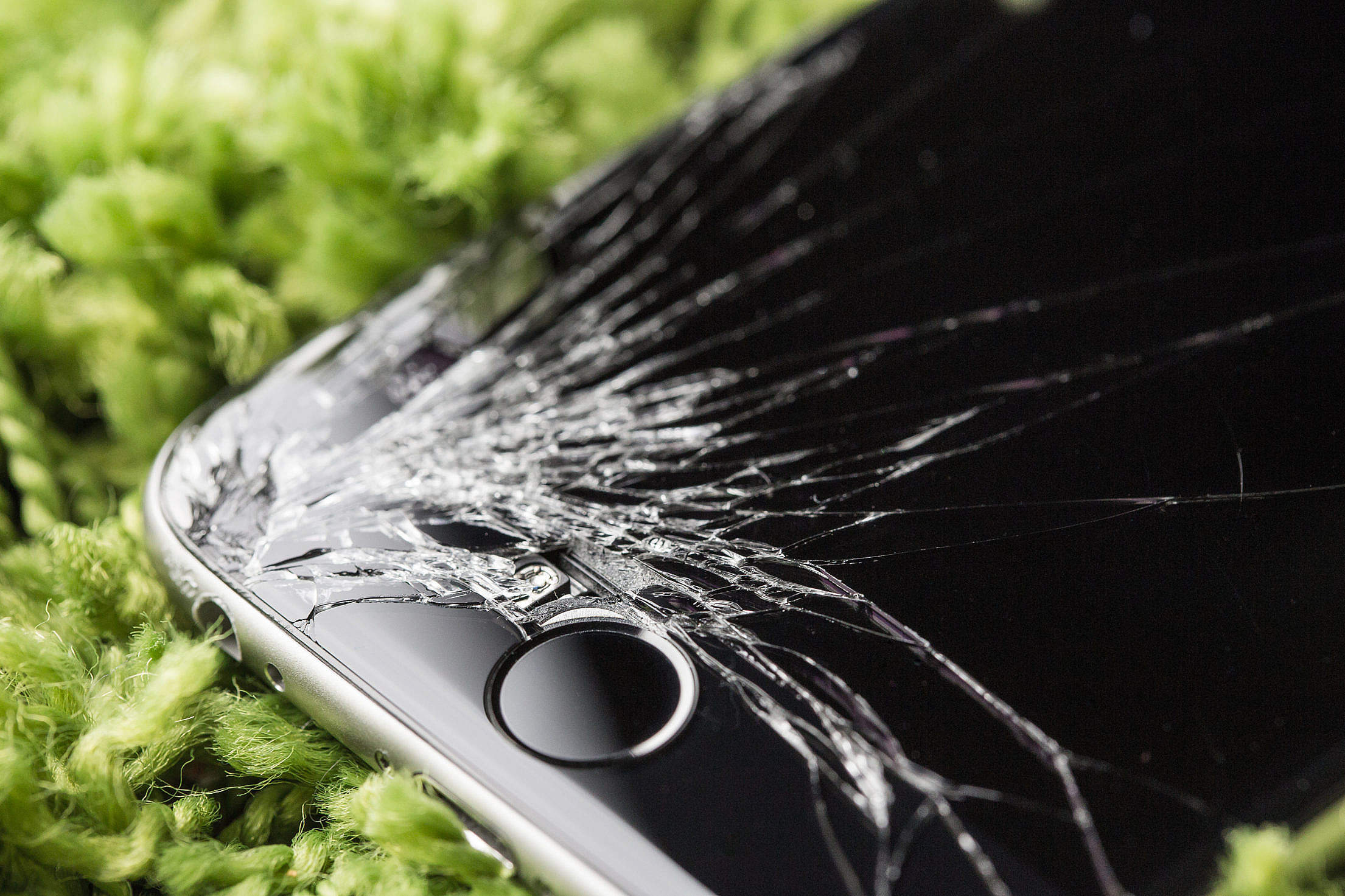 Dropped iPhone 6 with Cracked Screen Close Up Free Stock Photo