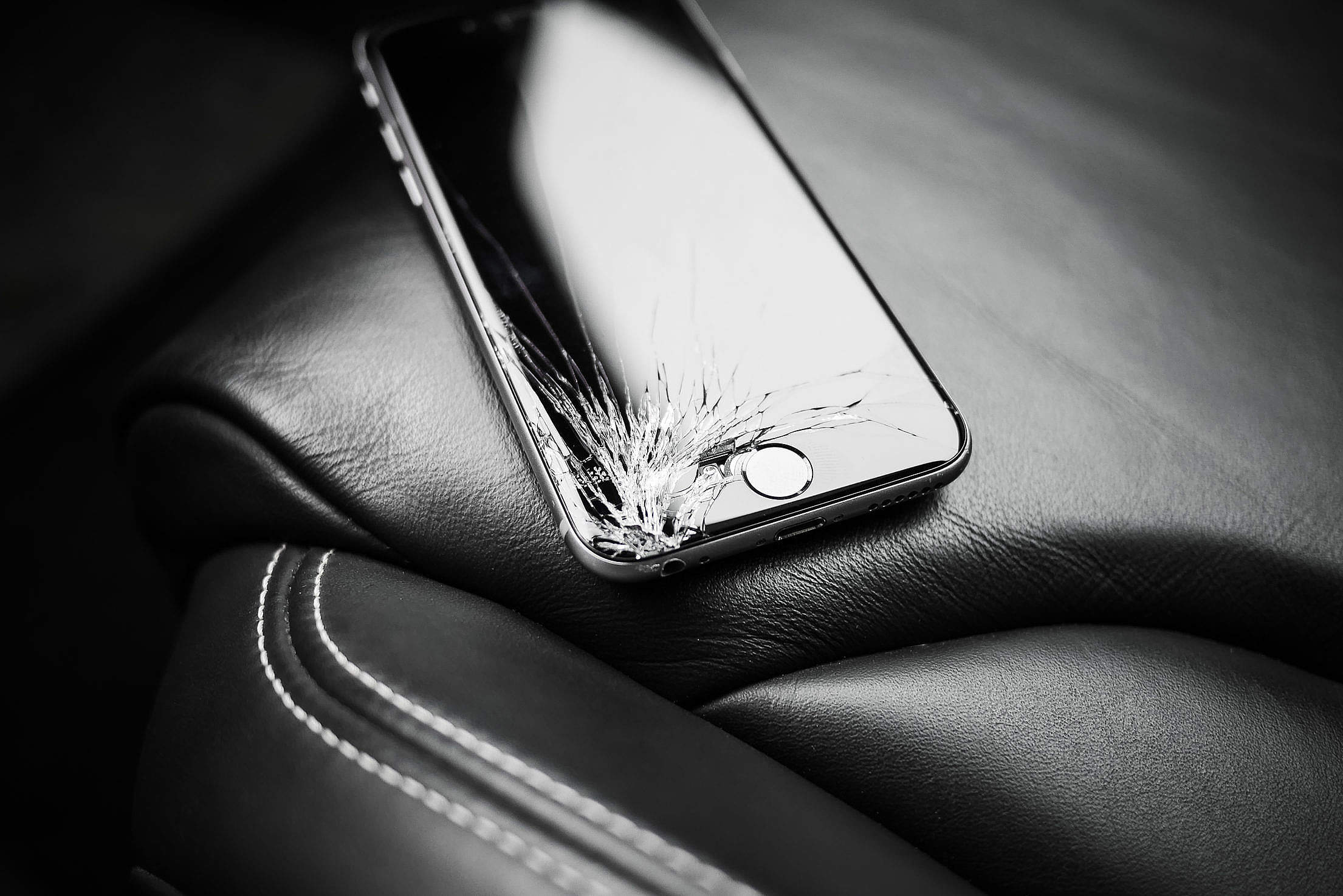Download Dropped iPhone 6 with Cracked Screen on Car Seat Free Stock Photo