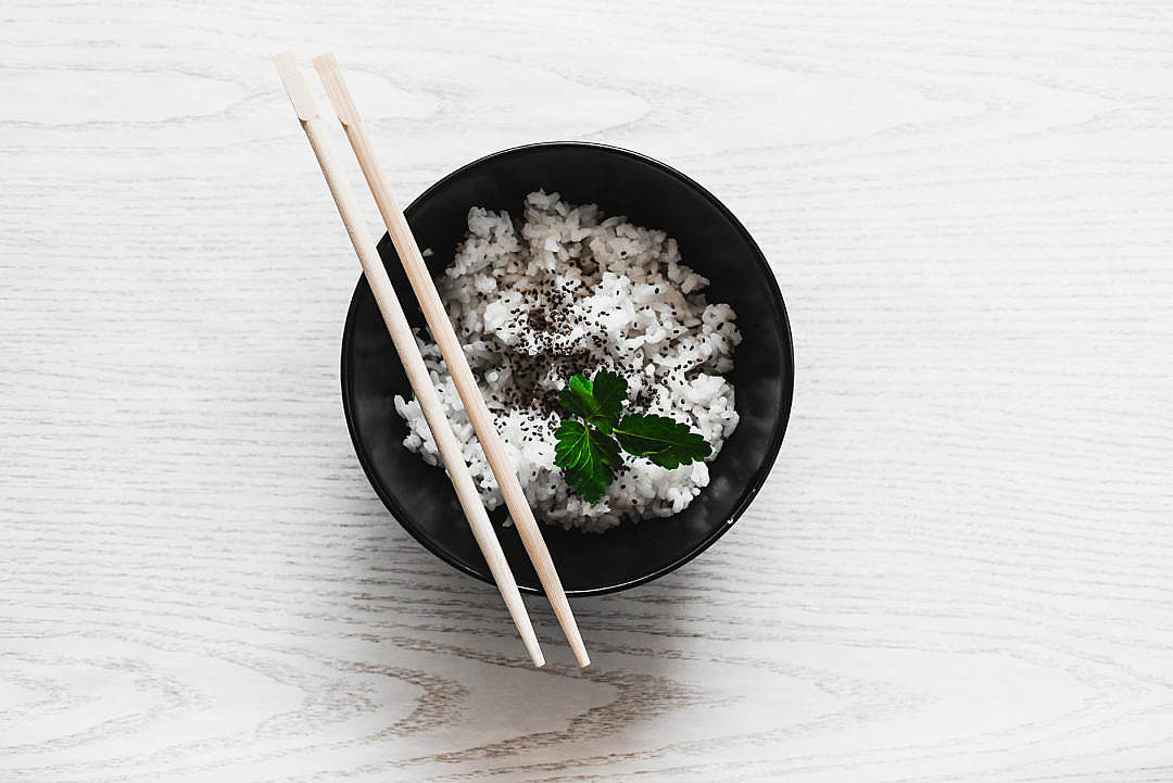 Download Eating Rice with Chopsticks FREE Stock Photo