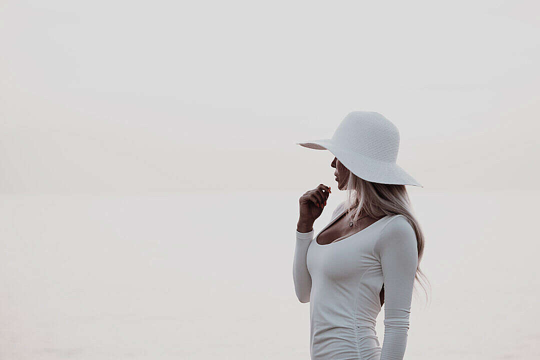 Download Elegant Woman in White Dress FREE Stock Photo