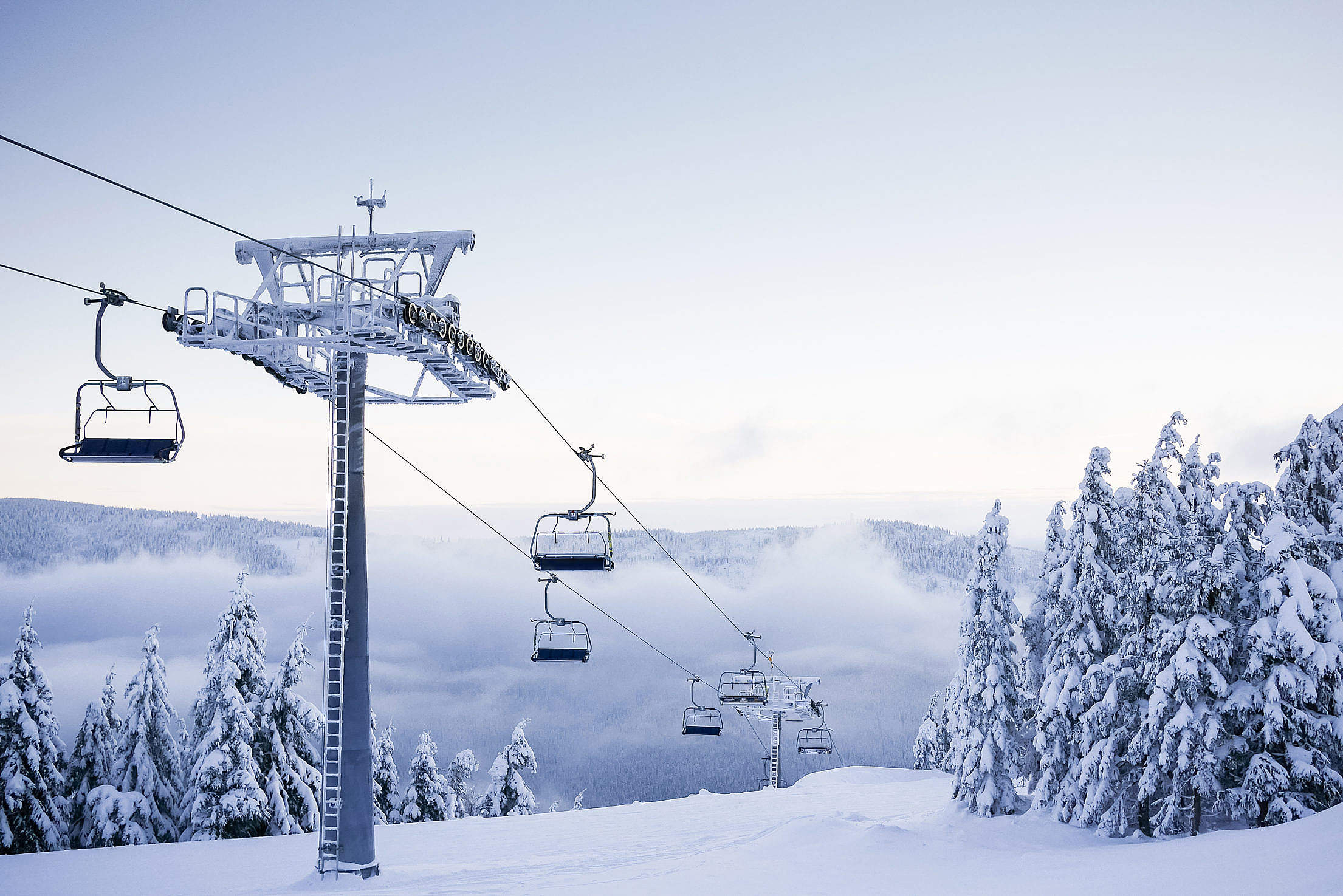 Empty Chair Ski Lift on Bright Winter Day Free Stock Photo