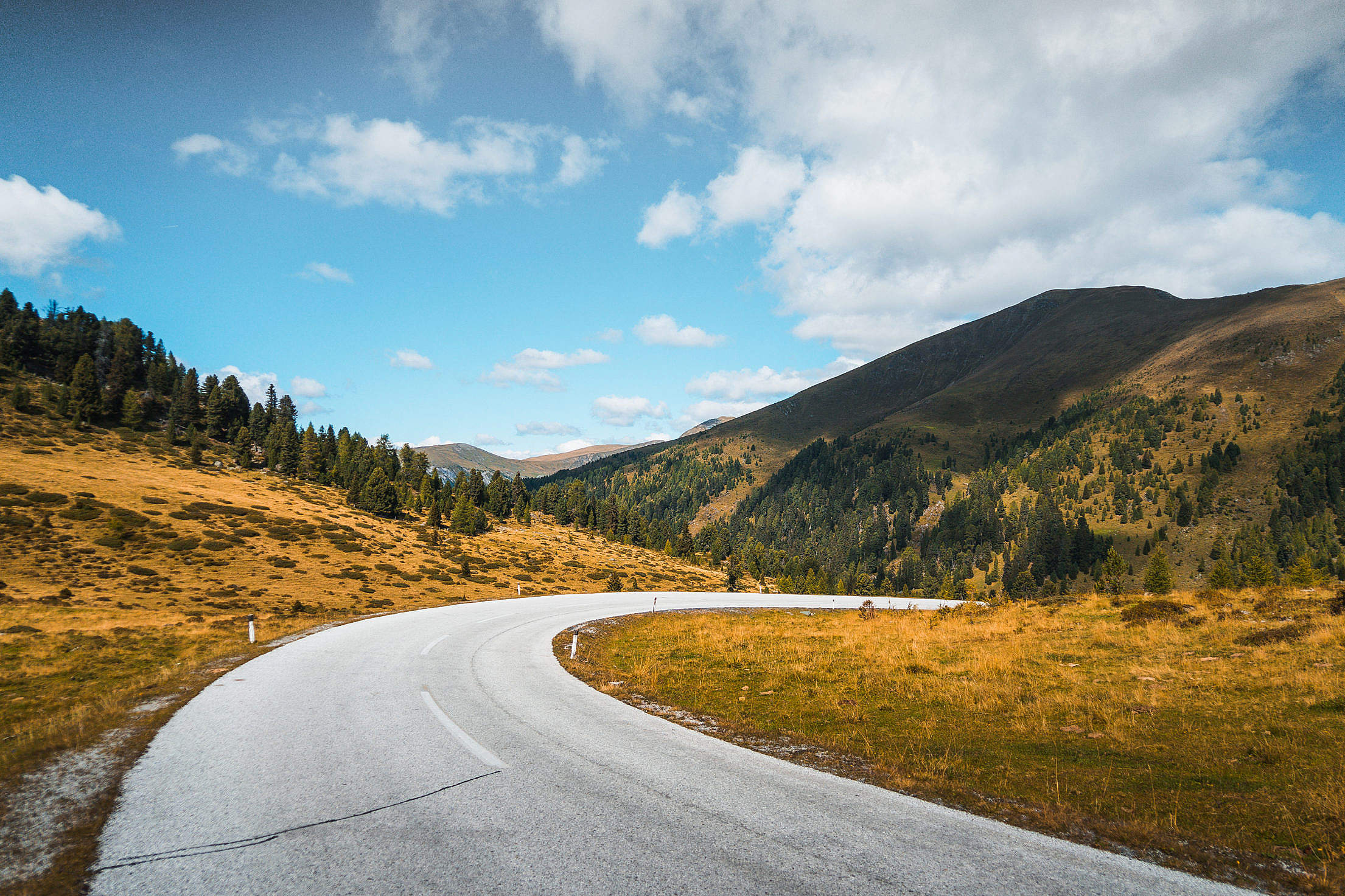 Download Empty Road in Austrian Mountains Free Stock Photo