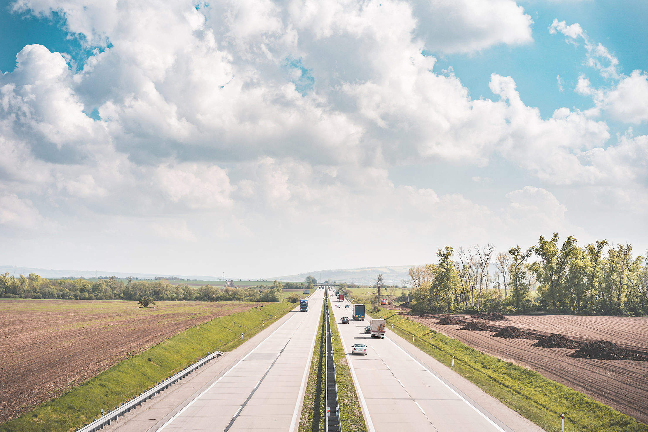 European Highway Surrounded by Fields Free Stock Photo