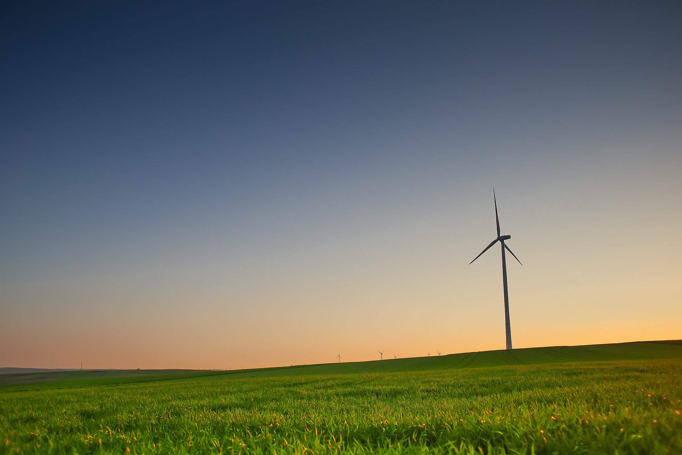 Evening Scenery with a Windmill Free Stock Photo