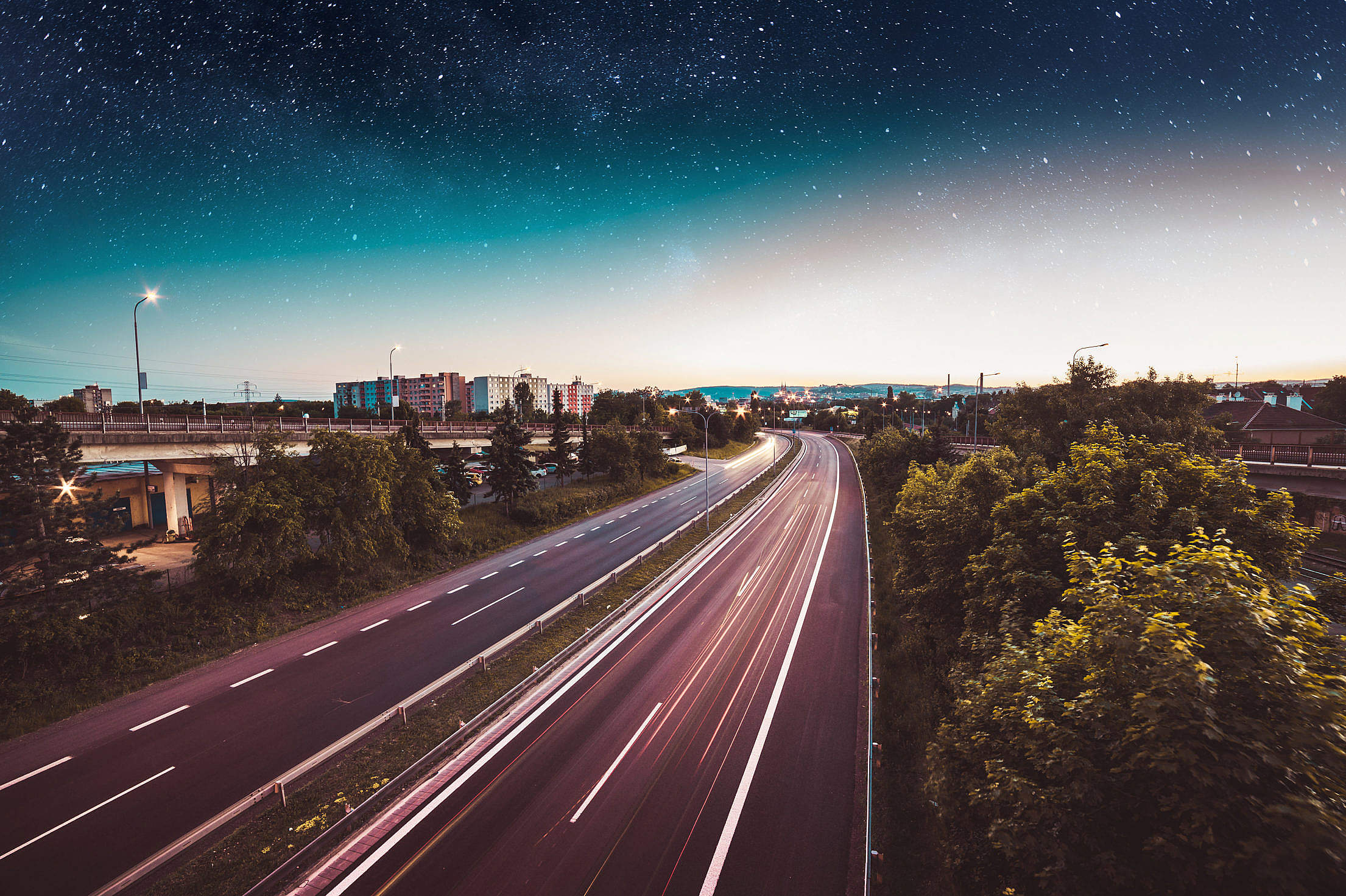 Evening Traffic in the City with Star Sky Free Stock Photo