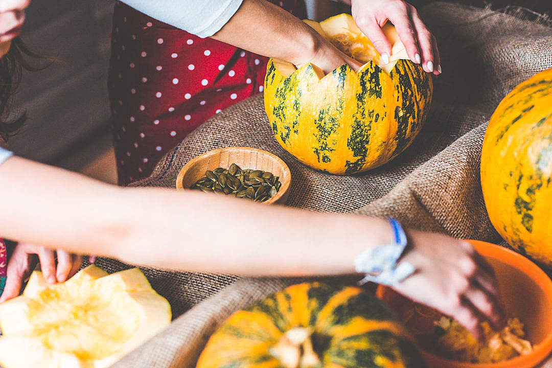 Download Family Time: Preparing and Carving Halloween Pumpkins FREE Stock Photo