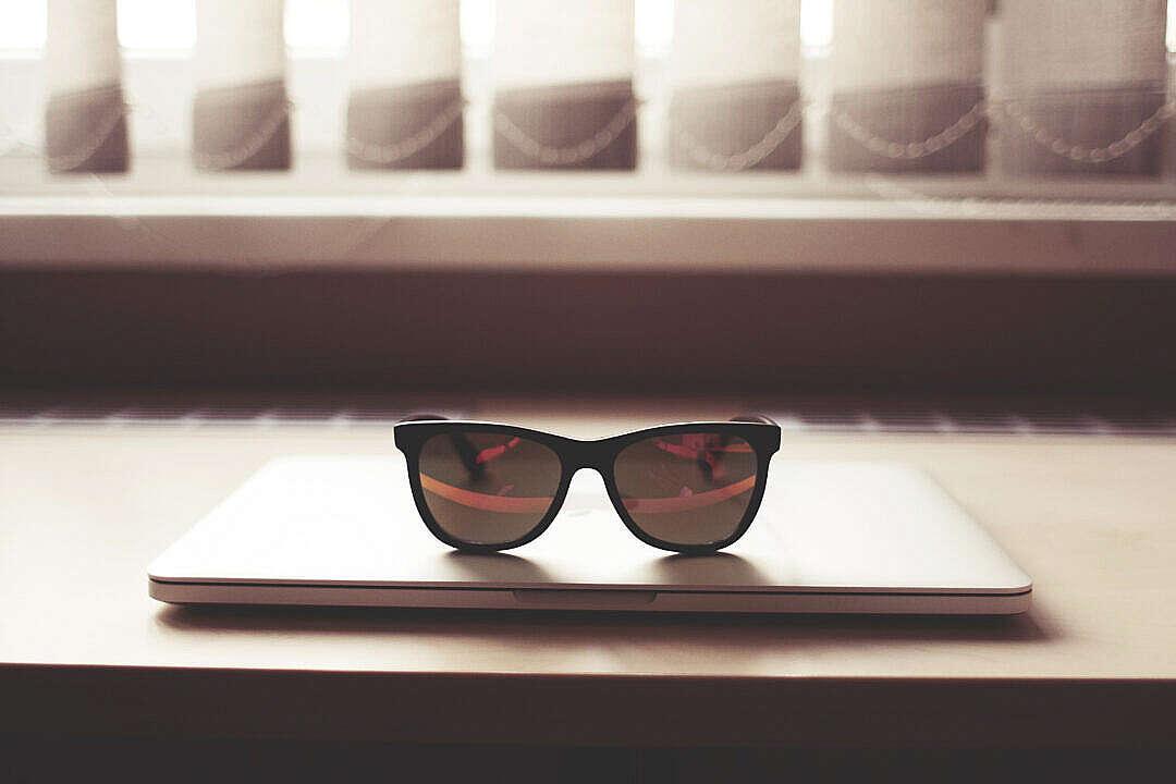 Download Fashion Glasses on MacBook Pro FREE Stock Photo