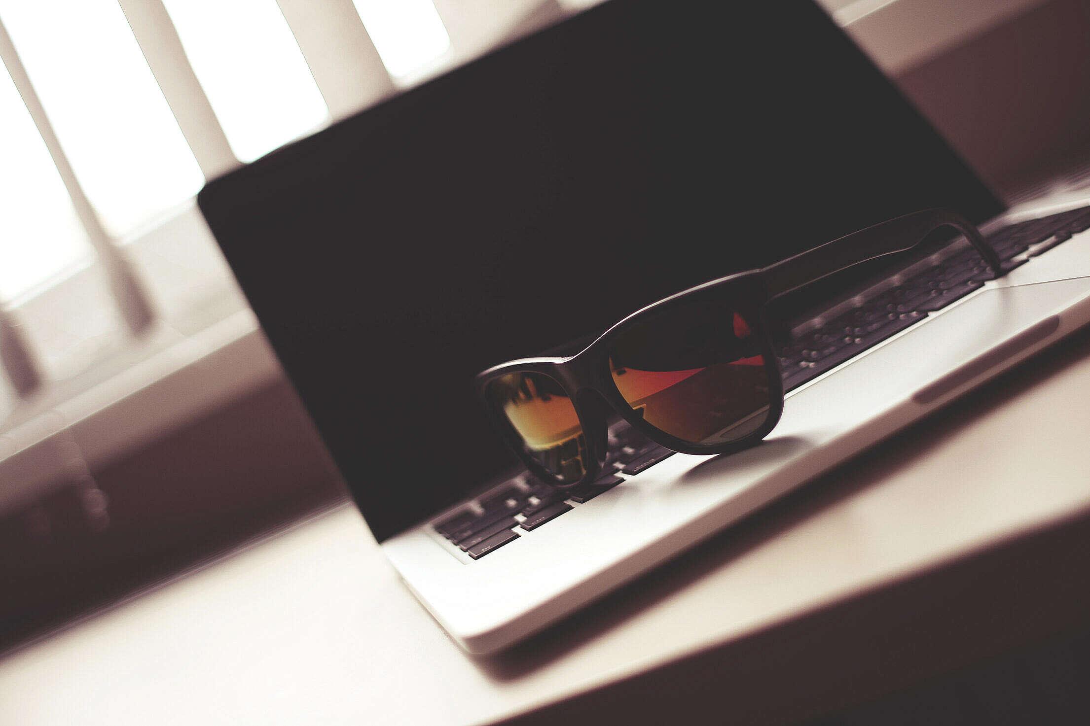 Fashion Sunglasses on a MacBook Free Stock Photo