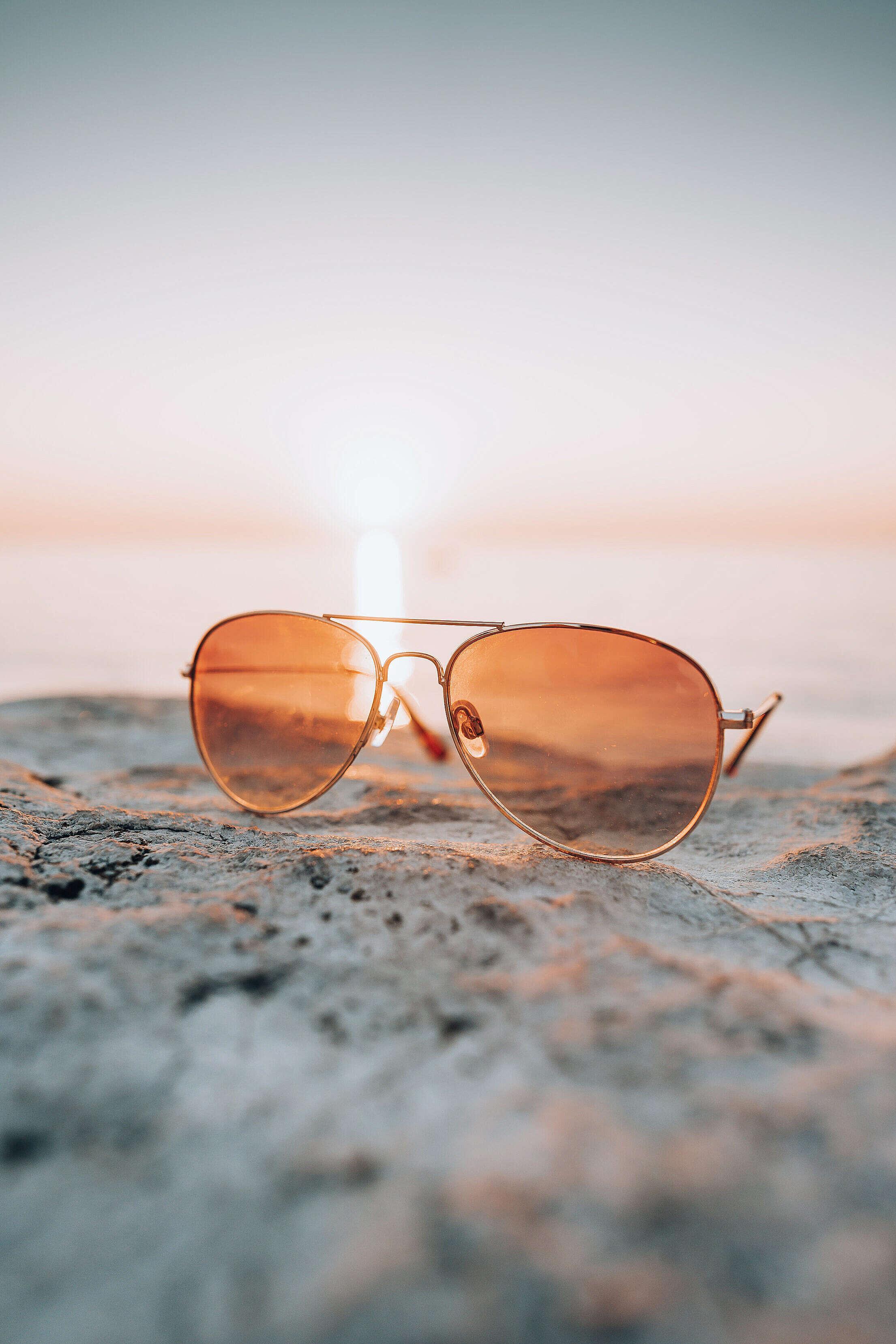 Fashion Sunglasses Sea Sunset and Stone Free Stock Photo