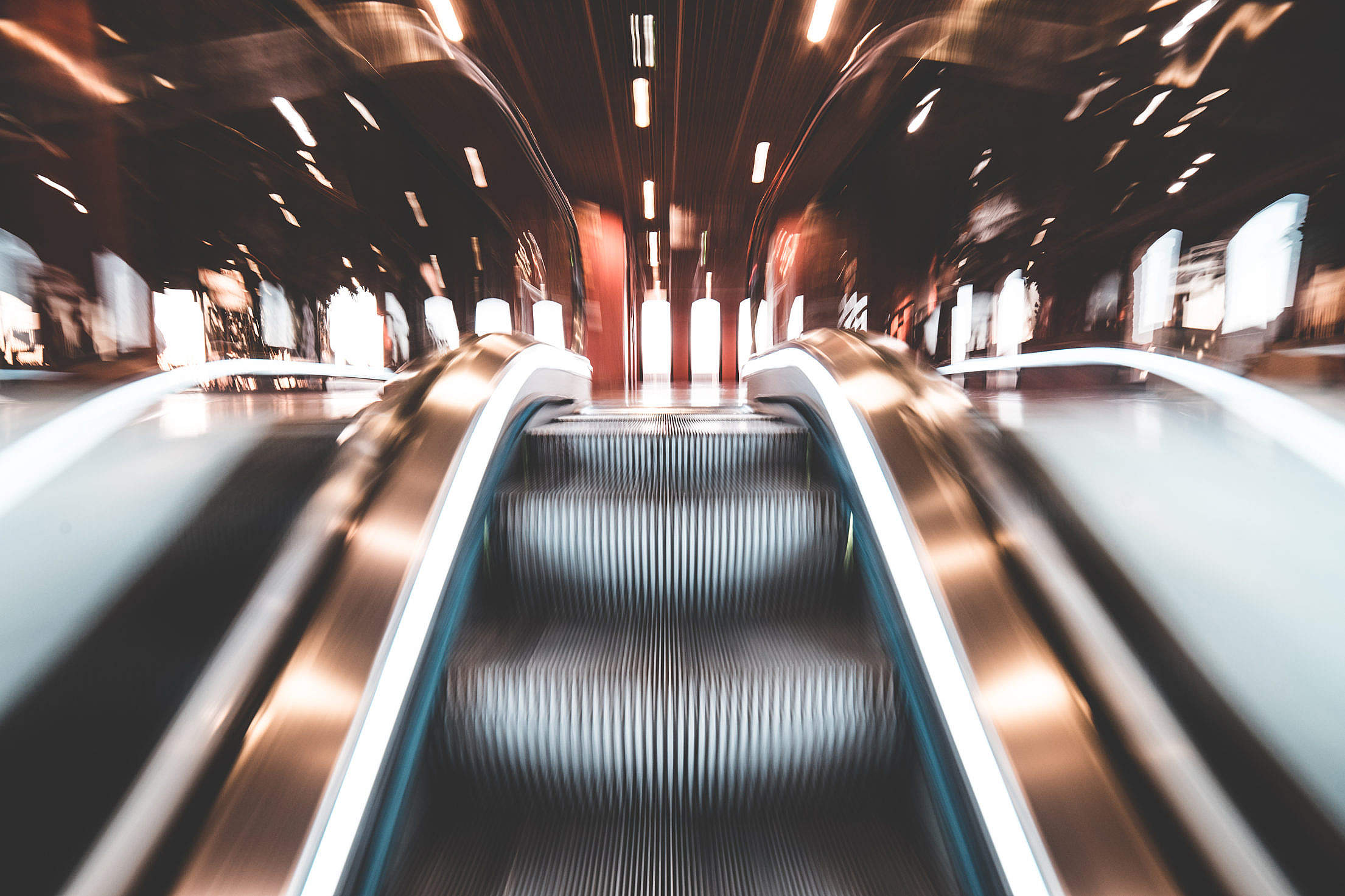 Fast Escalator and Abstract Lights Free Stock Photo
