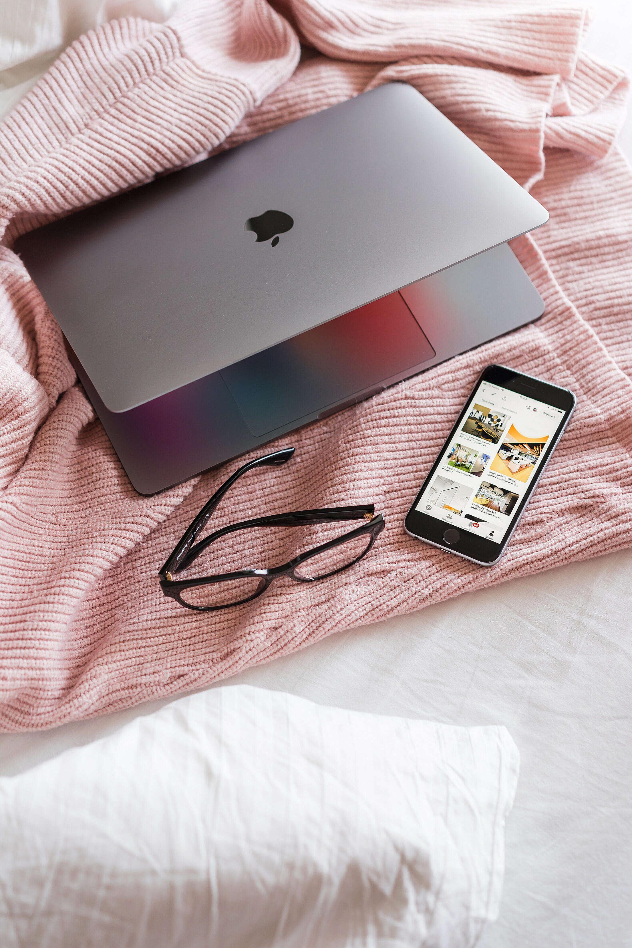 Feminine Ladypreneur Laptop and Smartphone on Bed Free Stock Photo