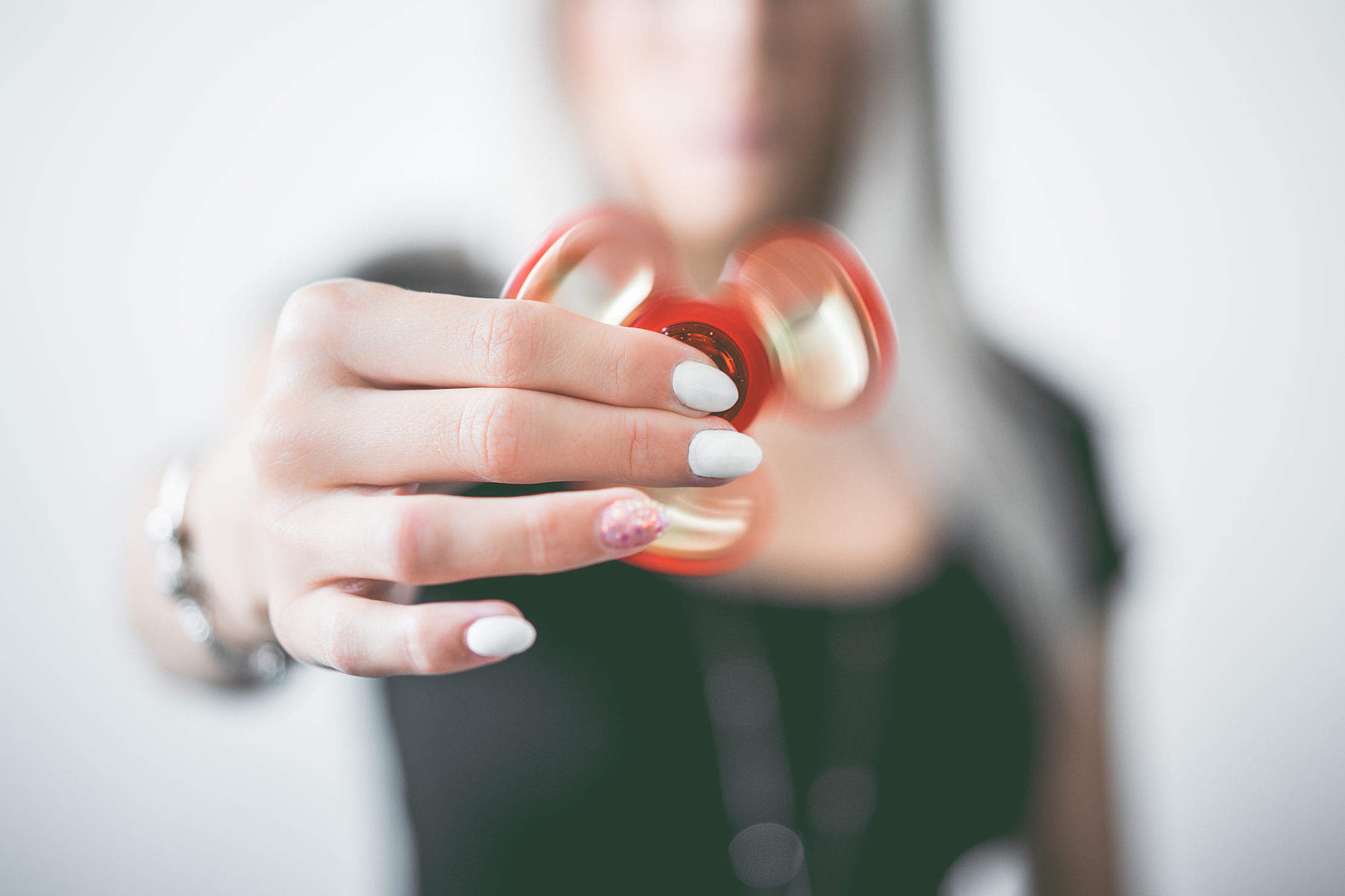 Fidget Spinner in Woman Hand Free Stock Photo