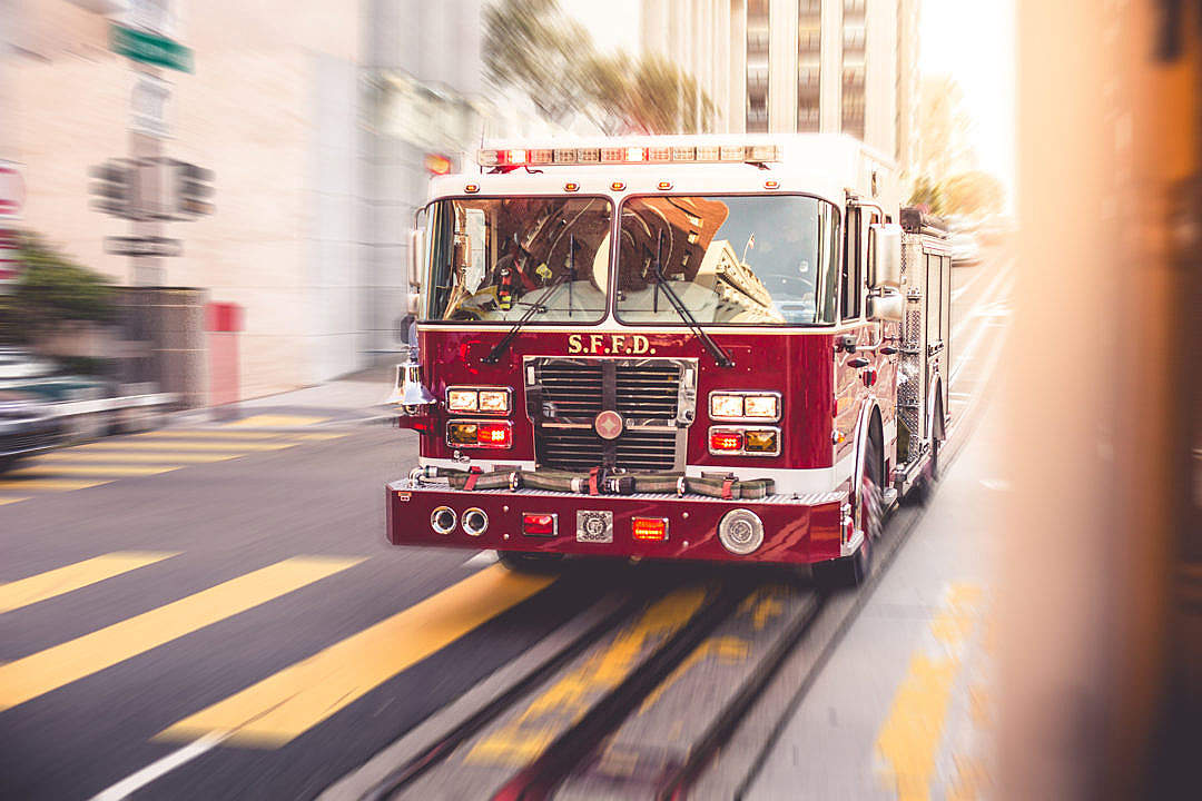Download Fire Truck Racing Through The City Traffic FREE Stock Photo