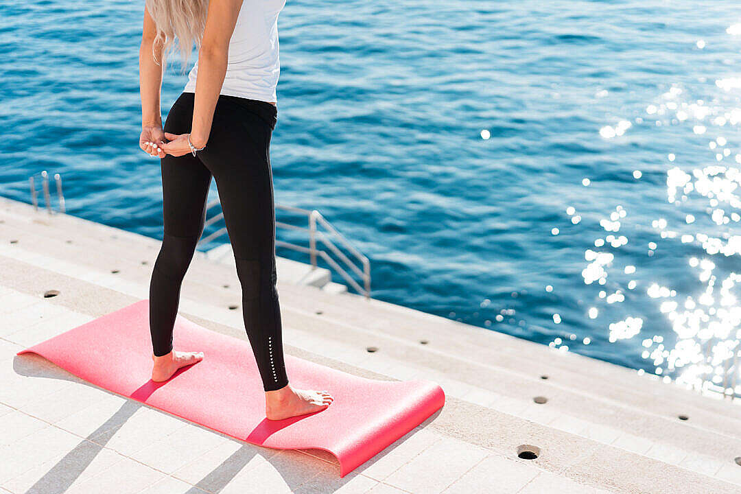 Download Fit Woman Stretching Her Body in Morning Yoga Routine FREE Stock Photo