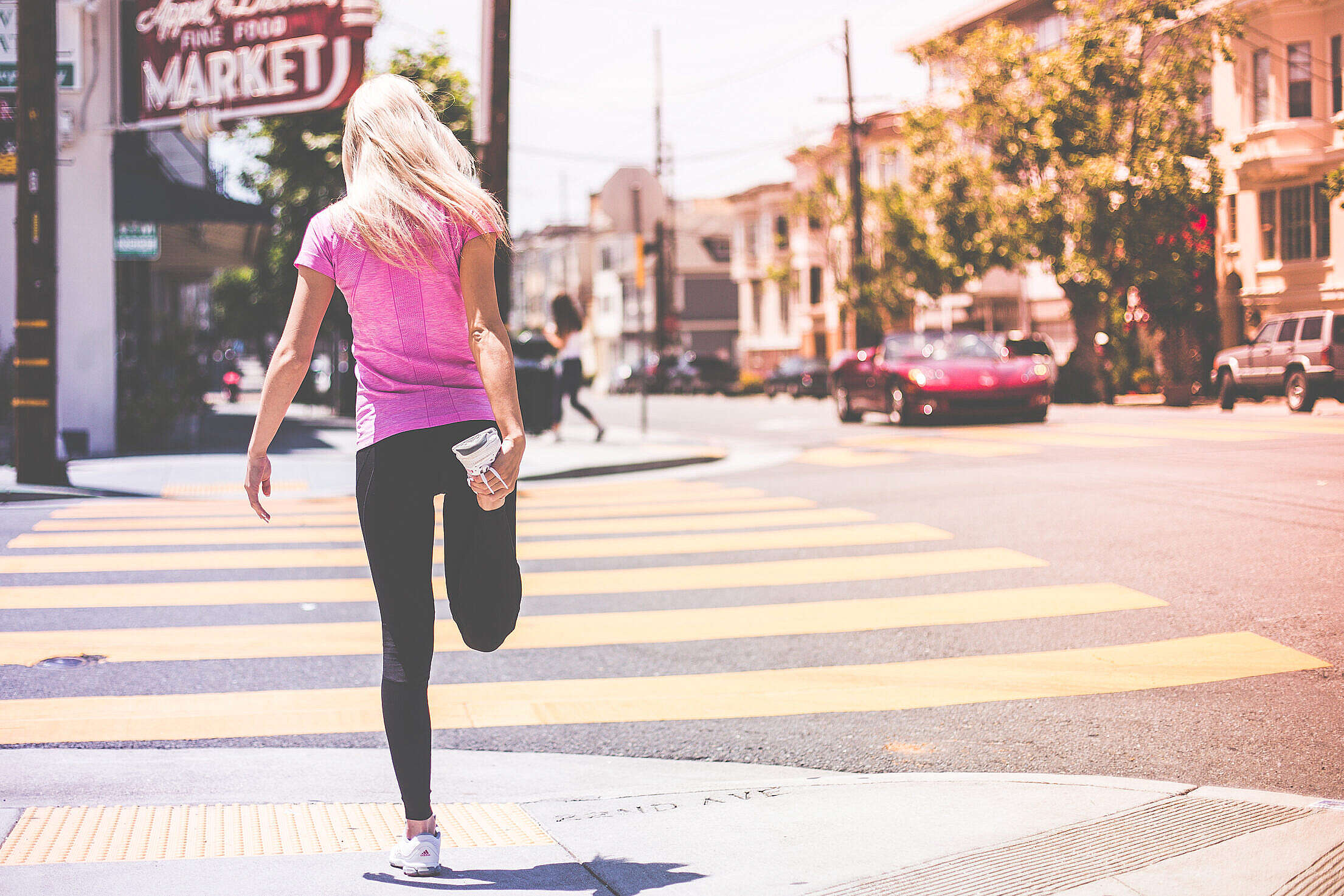 Fit Young Girl Stretching Her Legs Before Jogging Workout Free Stock Photo
