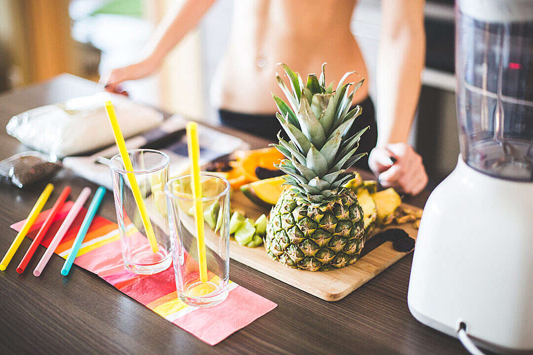 Download Fitness Girl Preparing Healthy Fruit Milkshake FREE Stock Photo